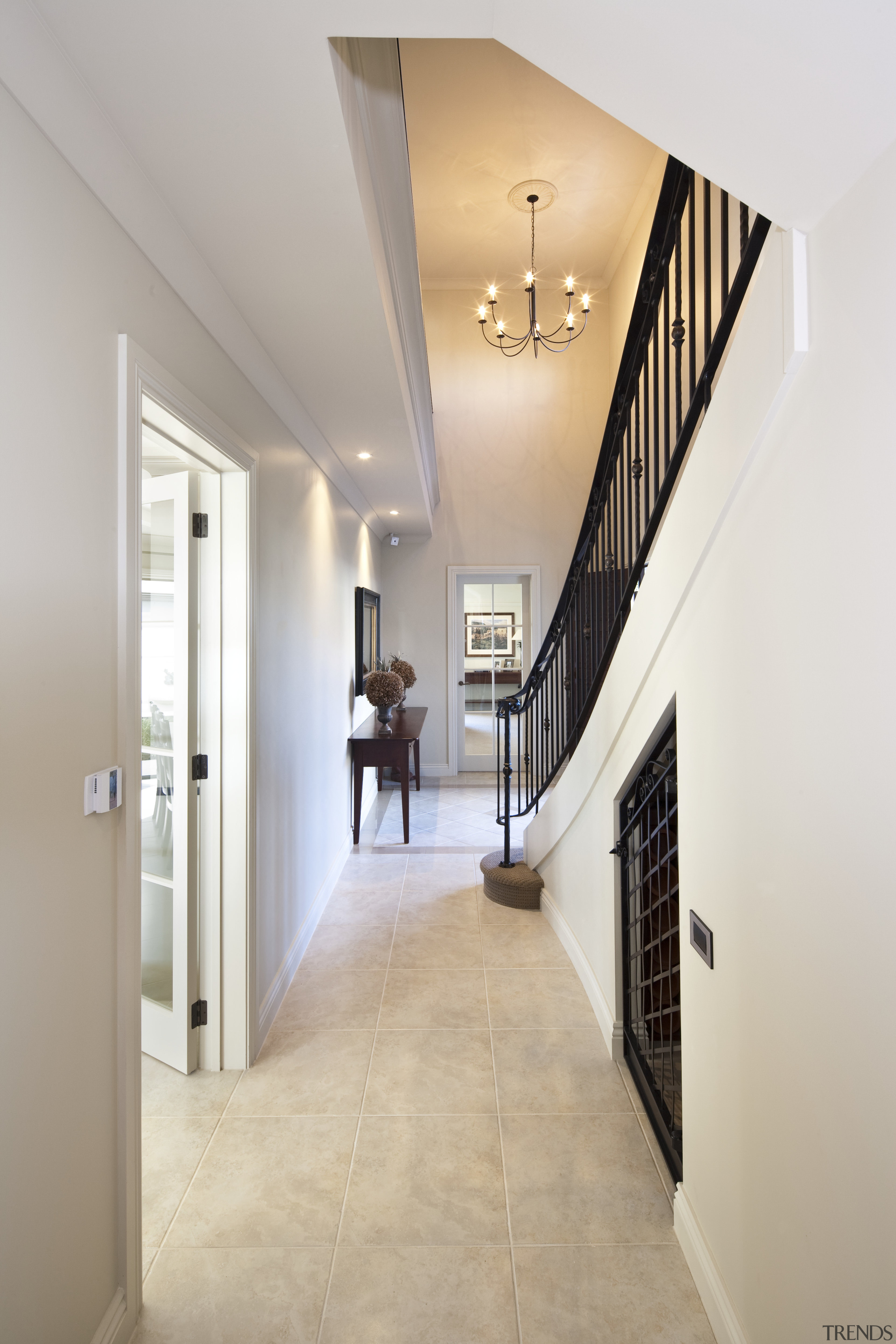 View of a hallway with tiled floors. - apartment, architecture, ceiling, daylighting, estate, floor, flooring, hall, handrail, home, house, interior design, lobby, property, real estate, stairs, wall, wood flooring, gray