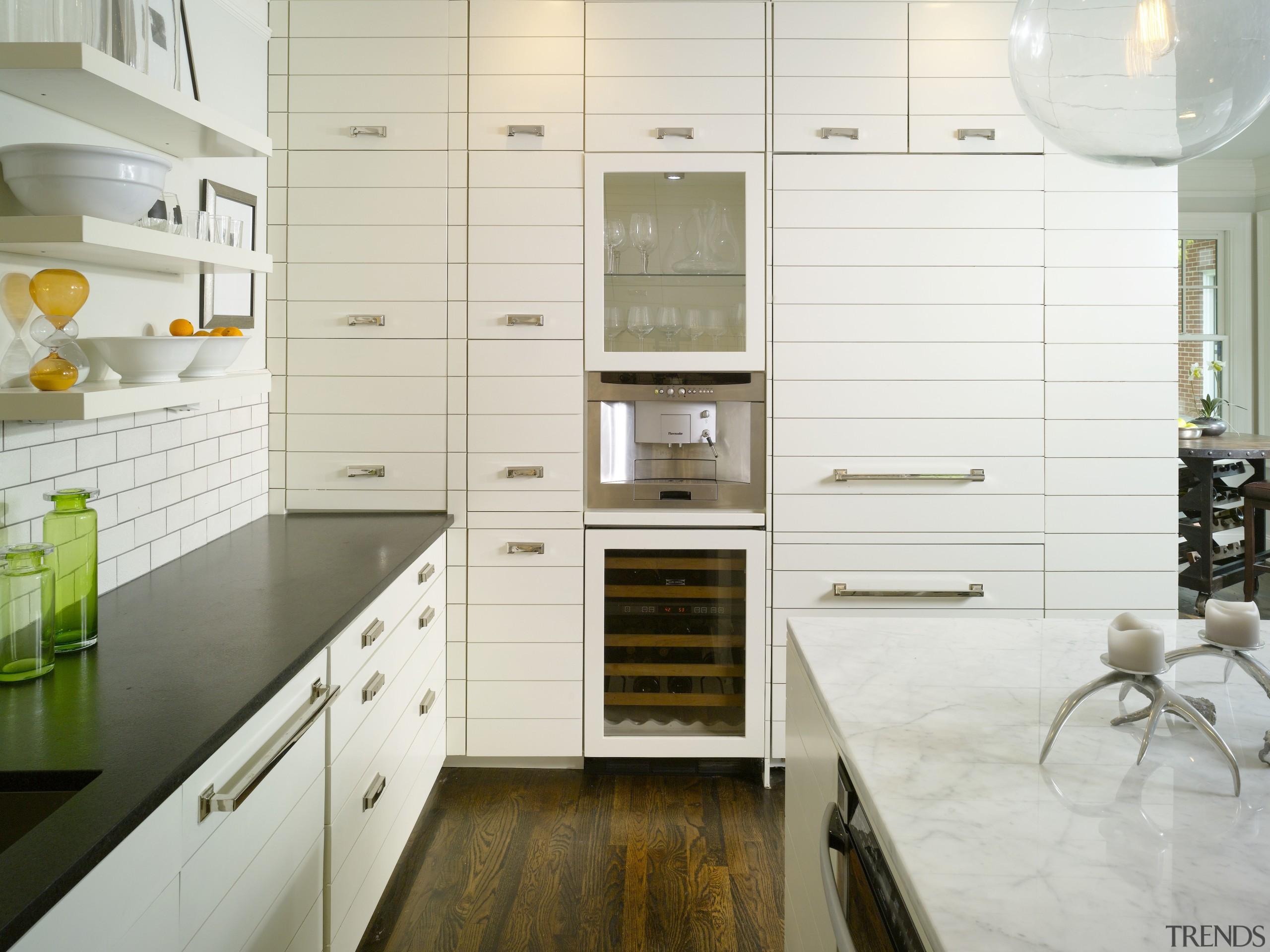 View of kitchen by Designer Willis Watts. Remodelled cabinetry, countertop, cuisine classique, floor, flooring, interior design, kitchen, room, white