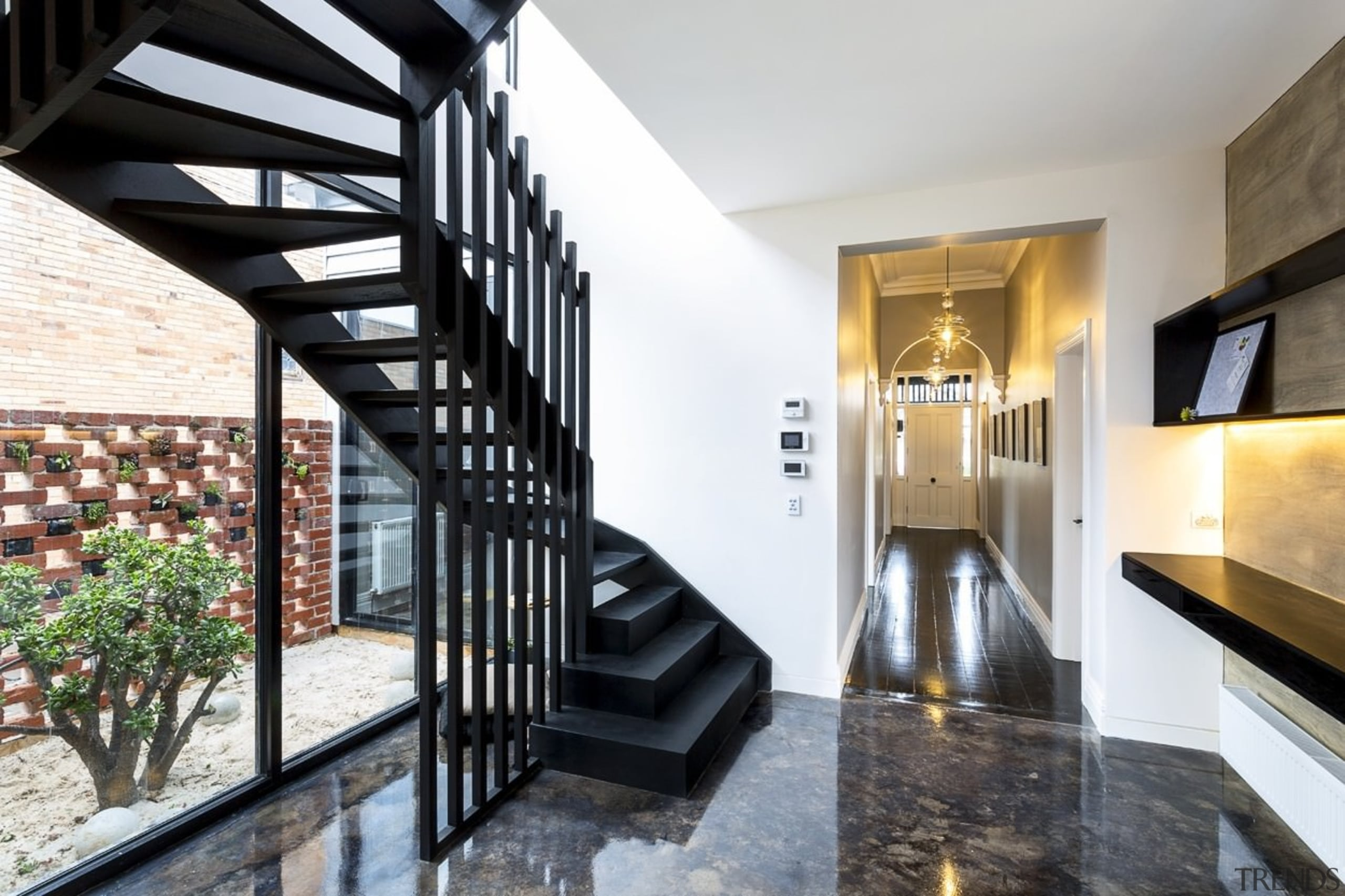 These windows flood the stairway and hallway with architecture, estate, handrail, home, house, interior design, property, real estate, stairs, white, black