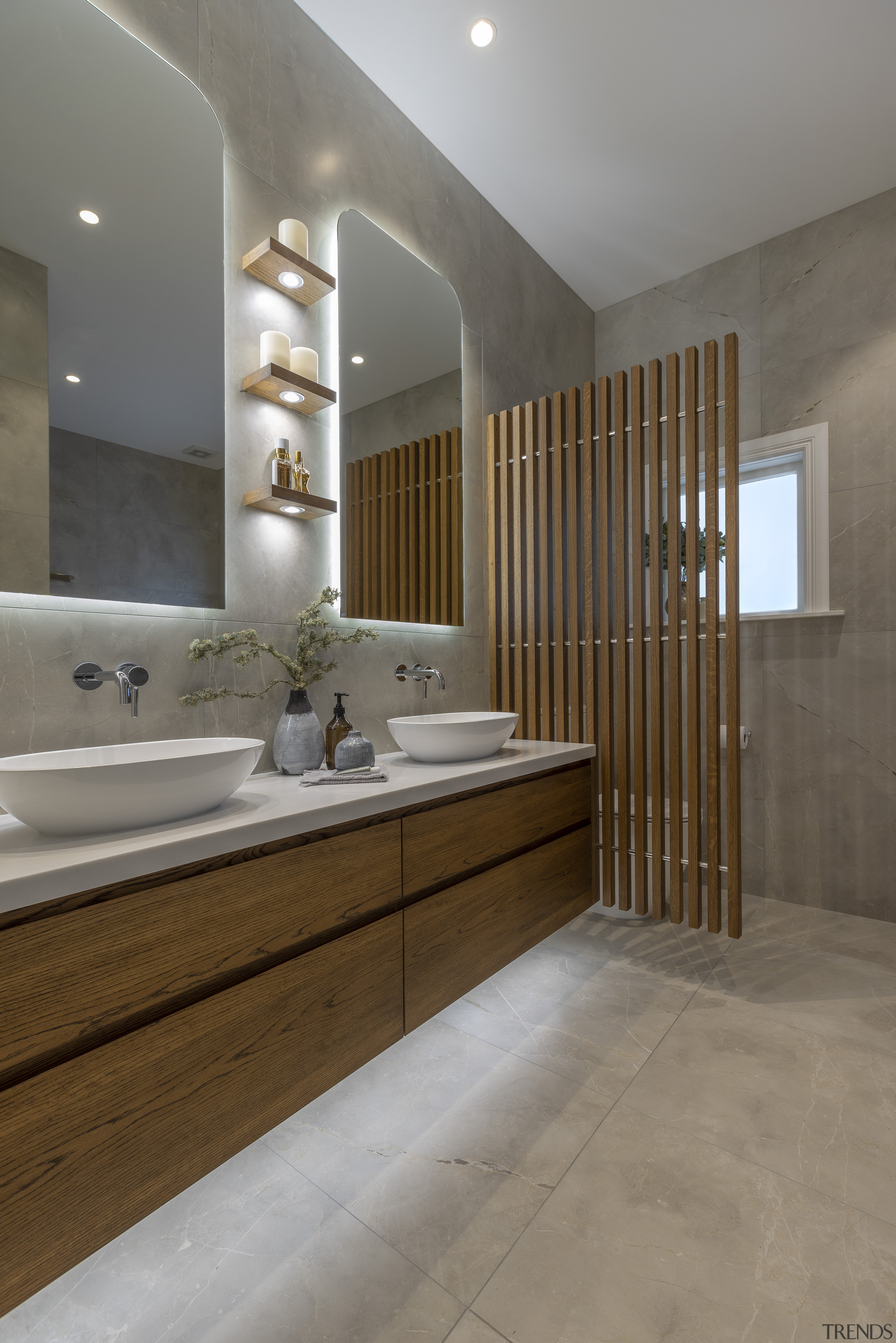 Two mirrors, two basins, and two sets of architecture, bathroom, bathroom accessory, bathroom cabinet, bathtub, beige, building, ceiling, floor, flooring, furniture, home, house, interior design, limestone, marble, material property, plumbing fixture, property, real estate, room, sink, tap, tile, wall, gray