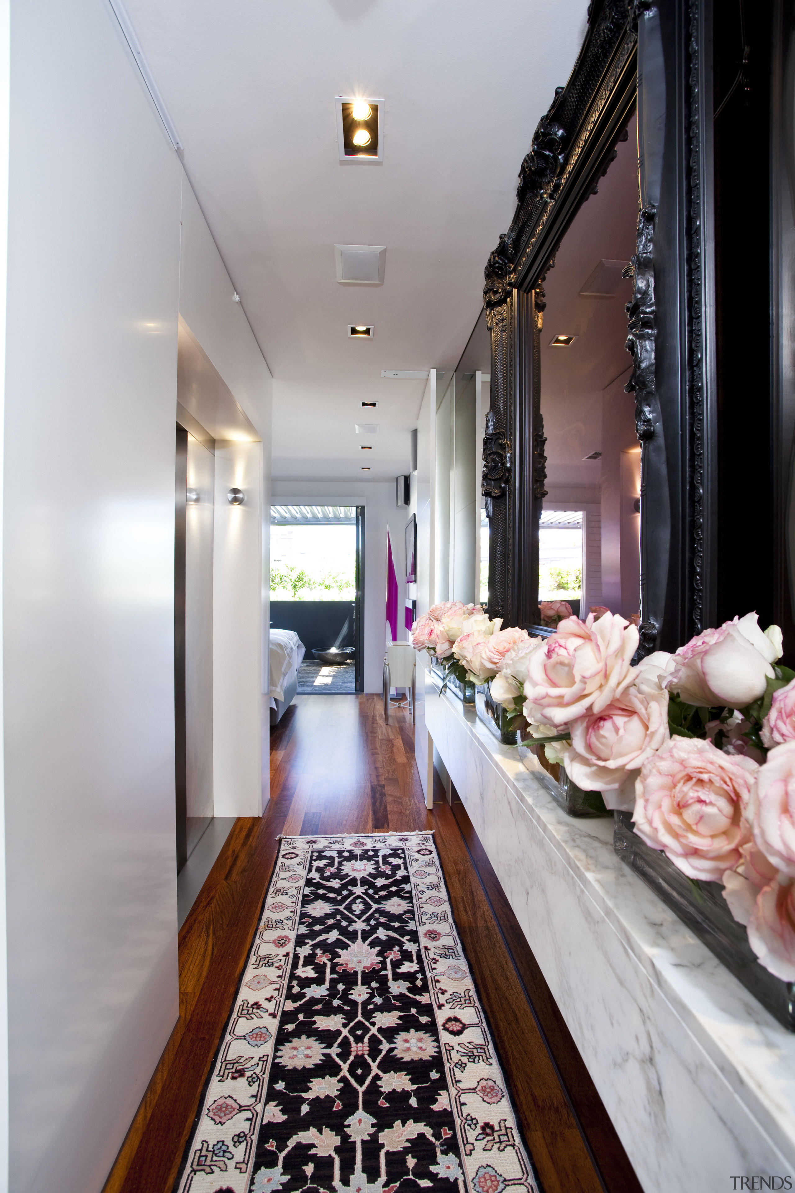 View of hallway with rug and flowers in aisle, ceiling, floor, flooring, interior design, room, gray