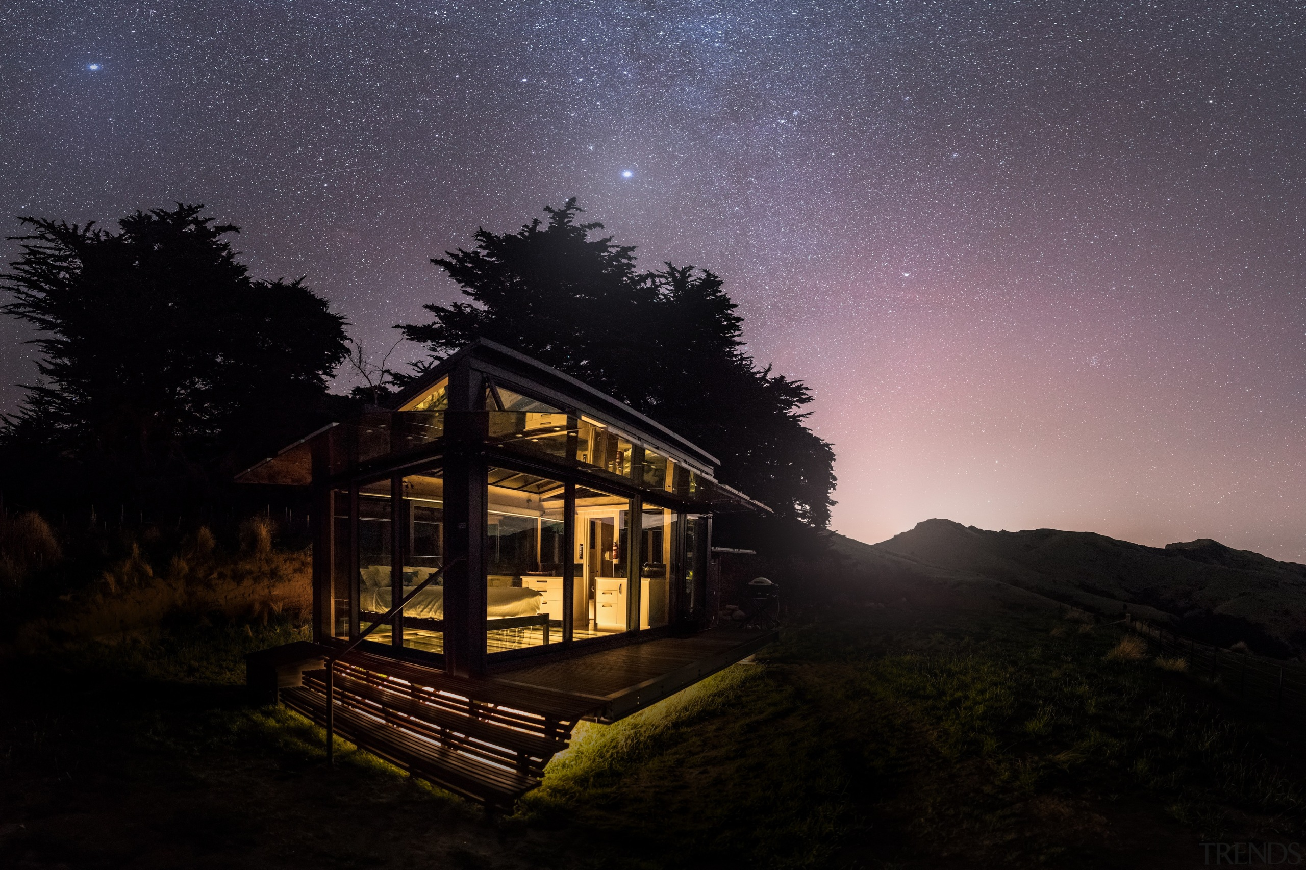 PurePod, New Zealand South Island, New Zealand - architecture, astronomical object, atmosphere, atmospheric phenomenon, building, cloud, cottage, darkness, home, house, hut, landscape, light, log cabin, midnight, moonlight, night, photography, sky, space, star, tree, black, gray