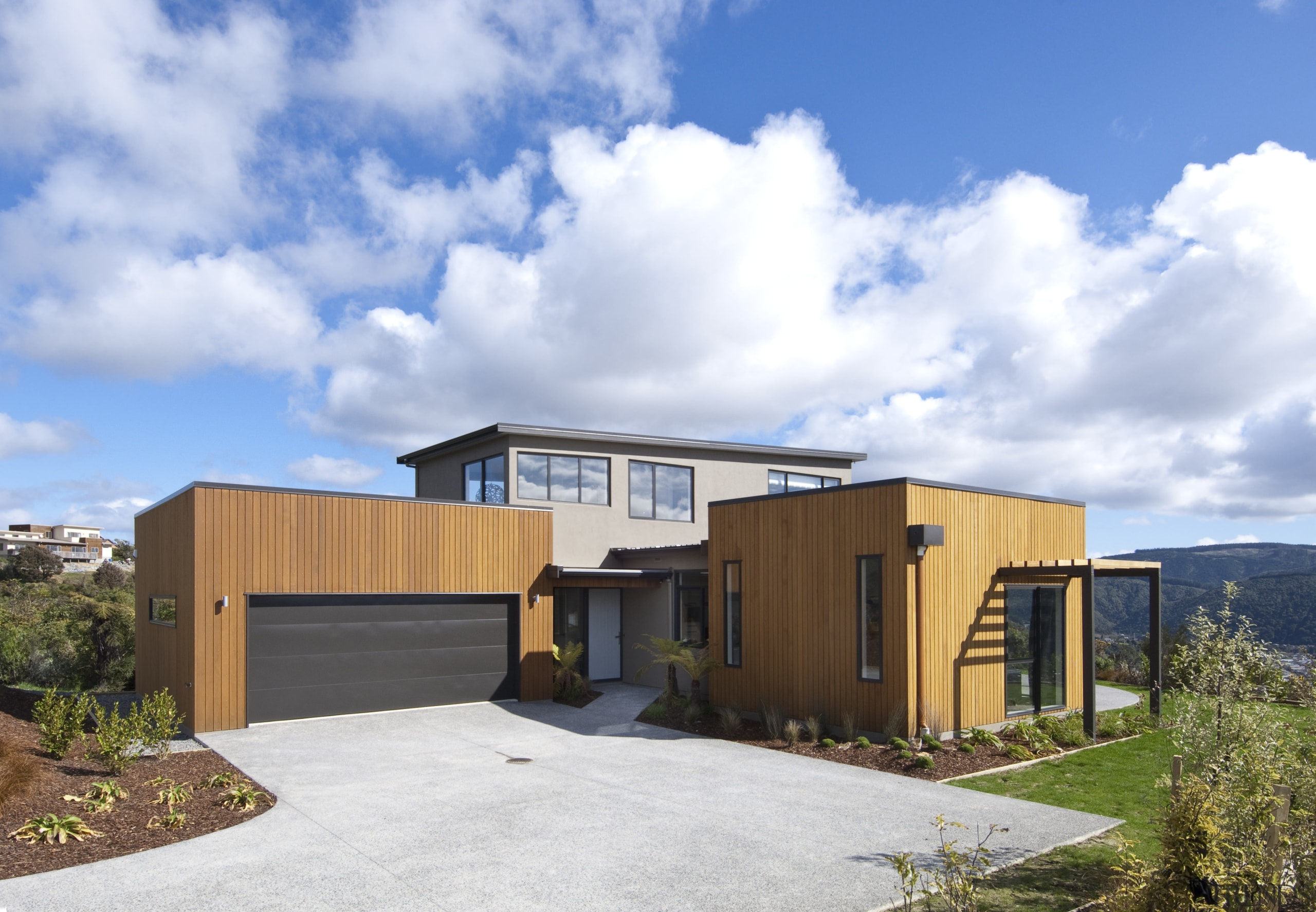 This Upper Hutt Show home was designed and architecture, elevation, facade, home, house, property, real estate, shed, sky, white