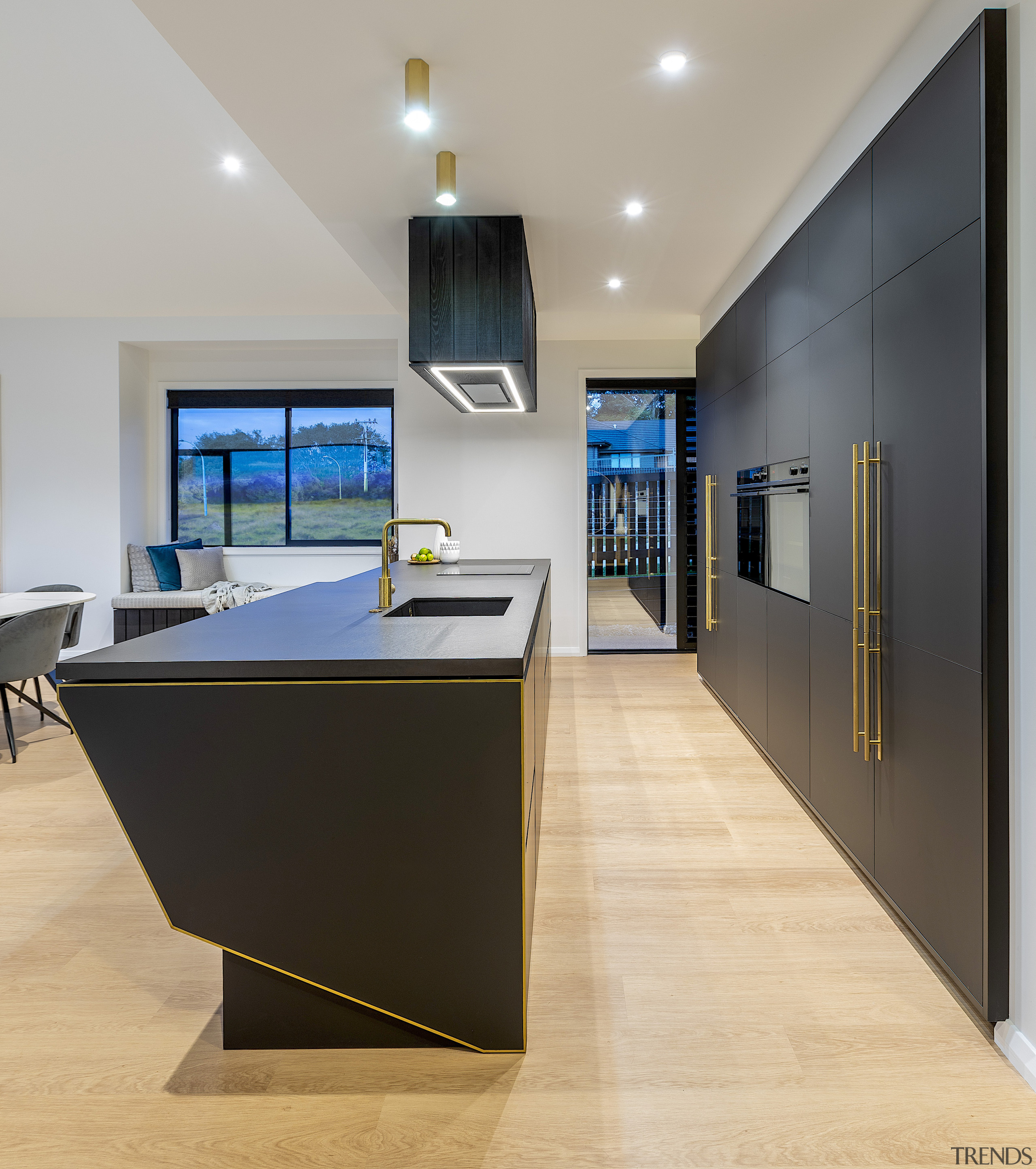 Brass fittings offer golden counterpoints in this dark