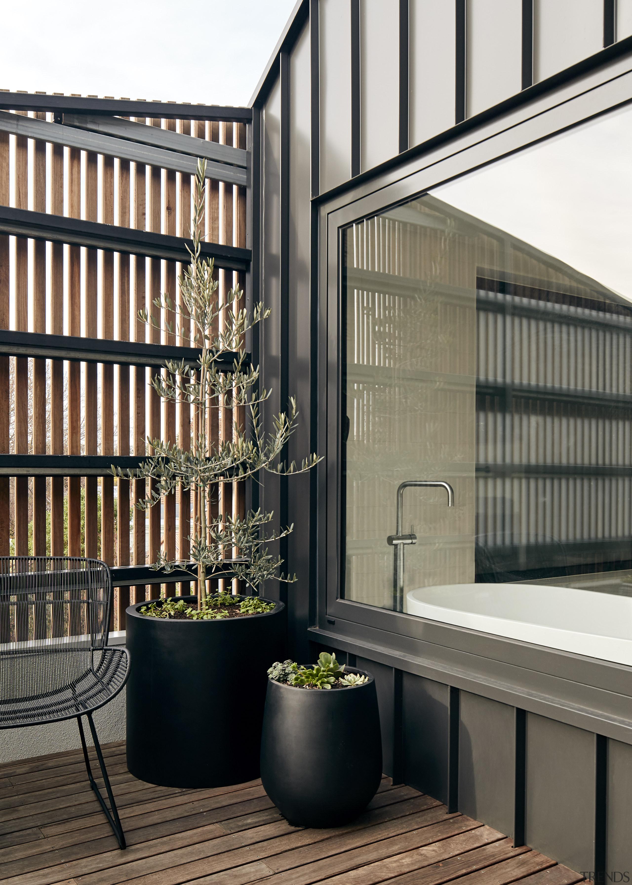 Even the private main bathroom has great outlooks architecture, balcony, building, facade, floor, furniture, house, interior design, room, shelf, black, gray