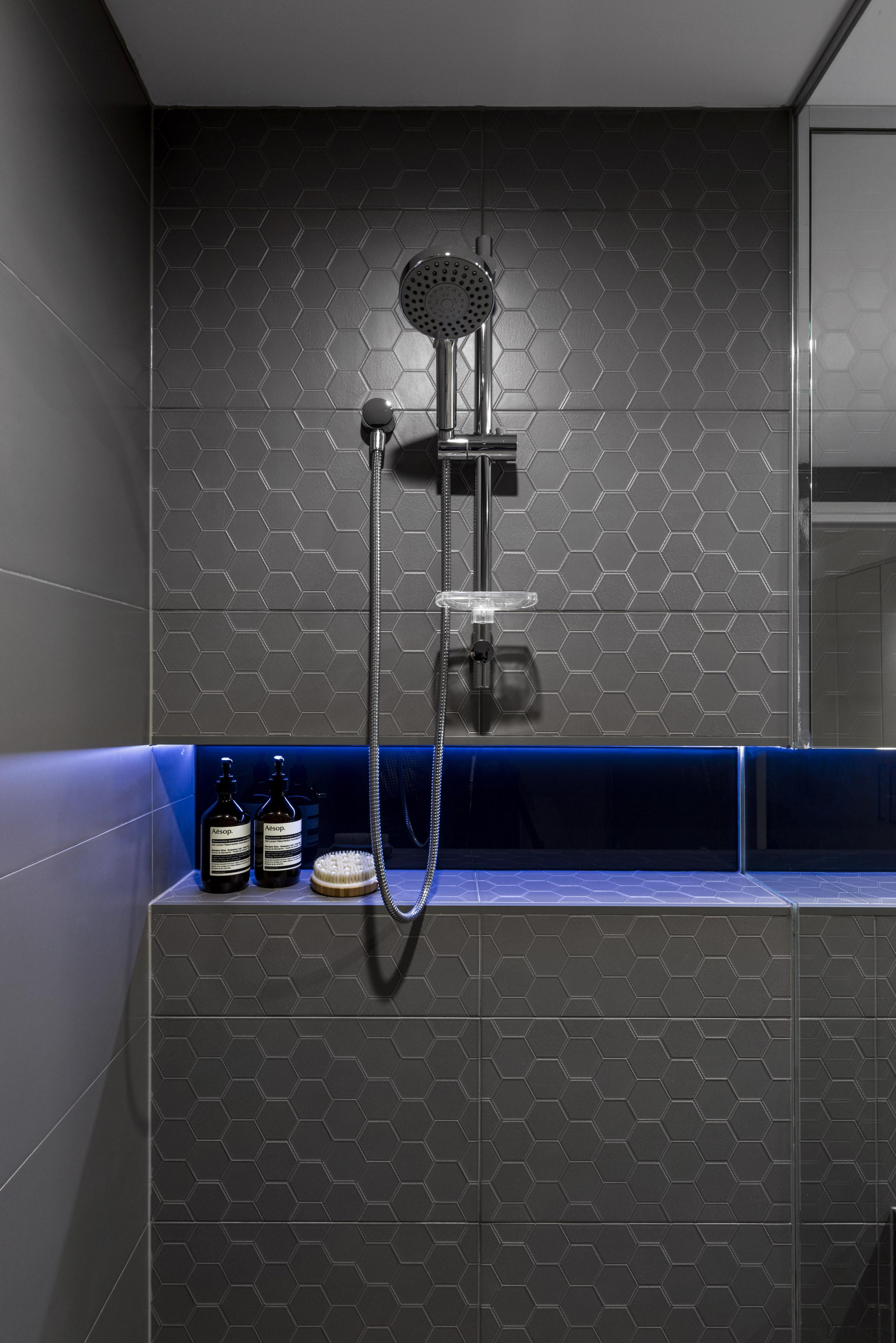 LED lights shining on charcoal glass splashback tiles angle, bathroom, floor, flooring, plumbing fixture, room, shower, tap, tile, toilet, wall, black, gray