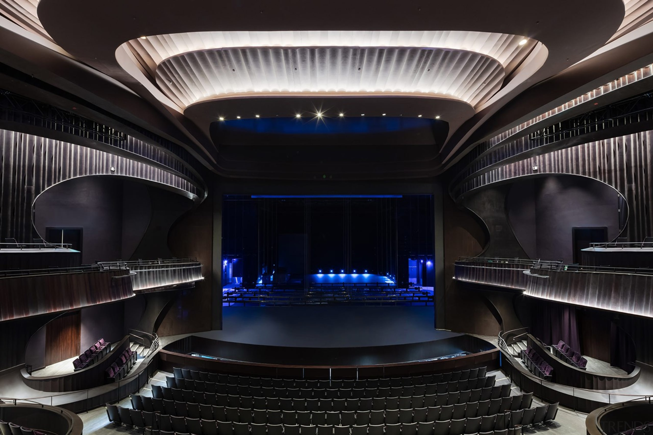 Formed from structural steel, the Grand Theatre is architecture, auditorium, building, ceiling, interior design, performing arts center, photography, room, sky, stage, black