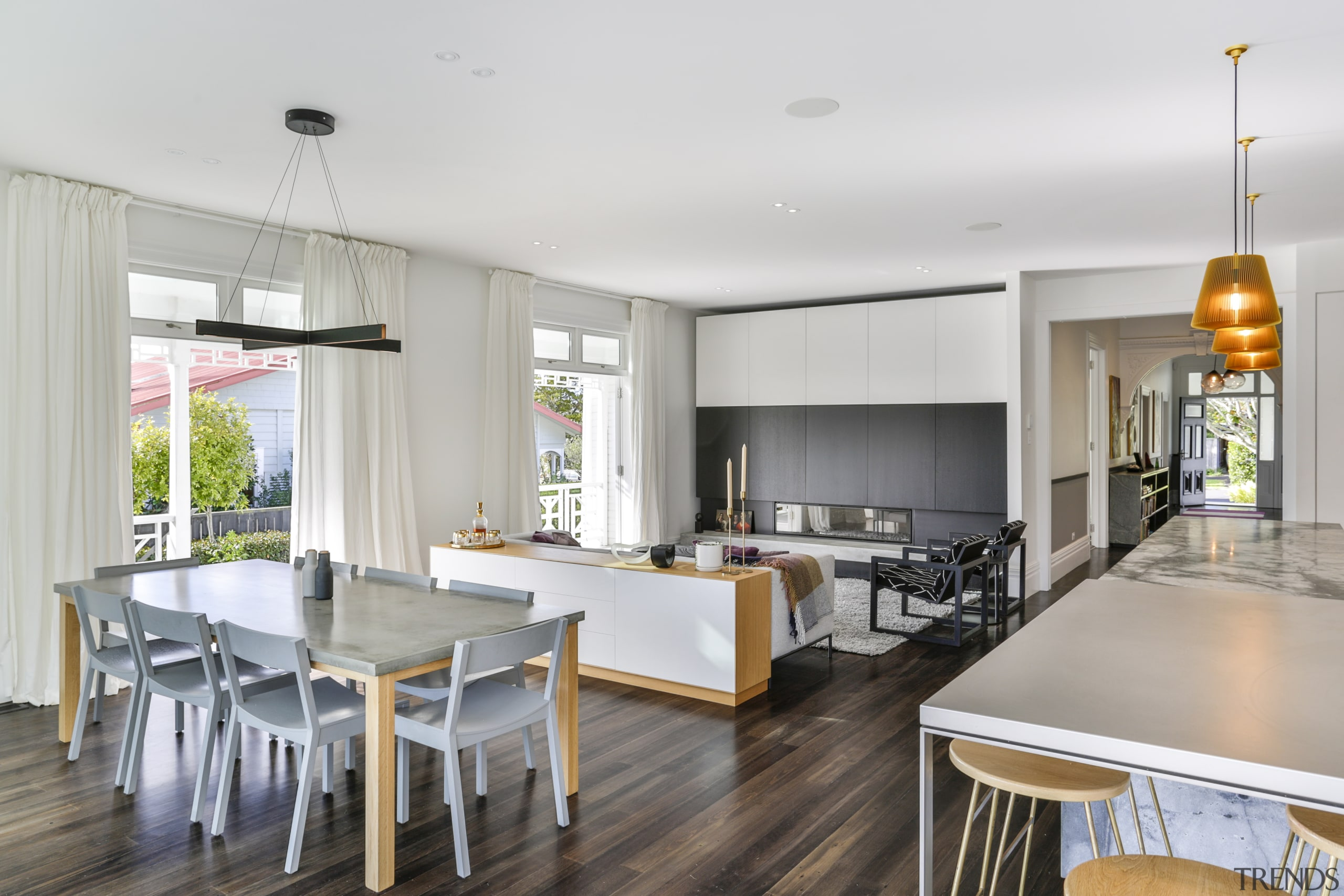 On this home renovation, he new living area dining room, interior design, dining table, kitchen, timber floor, living room, Matt Brew