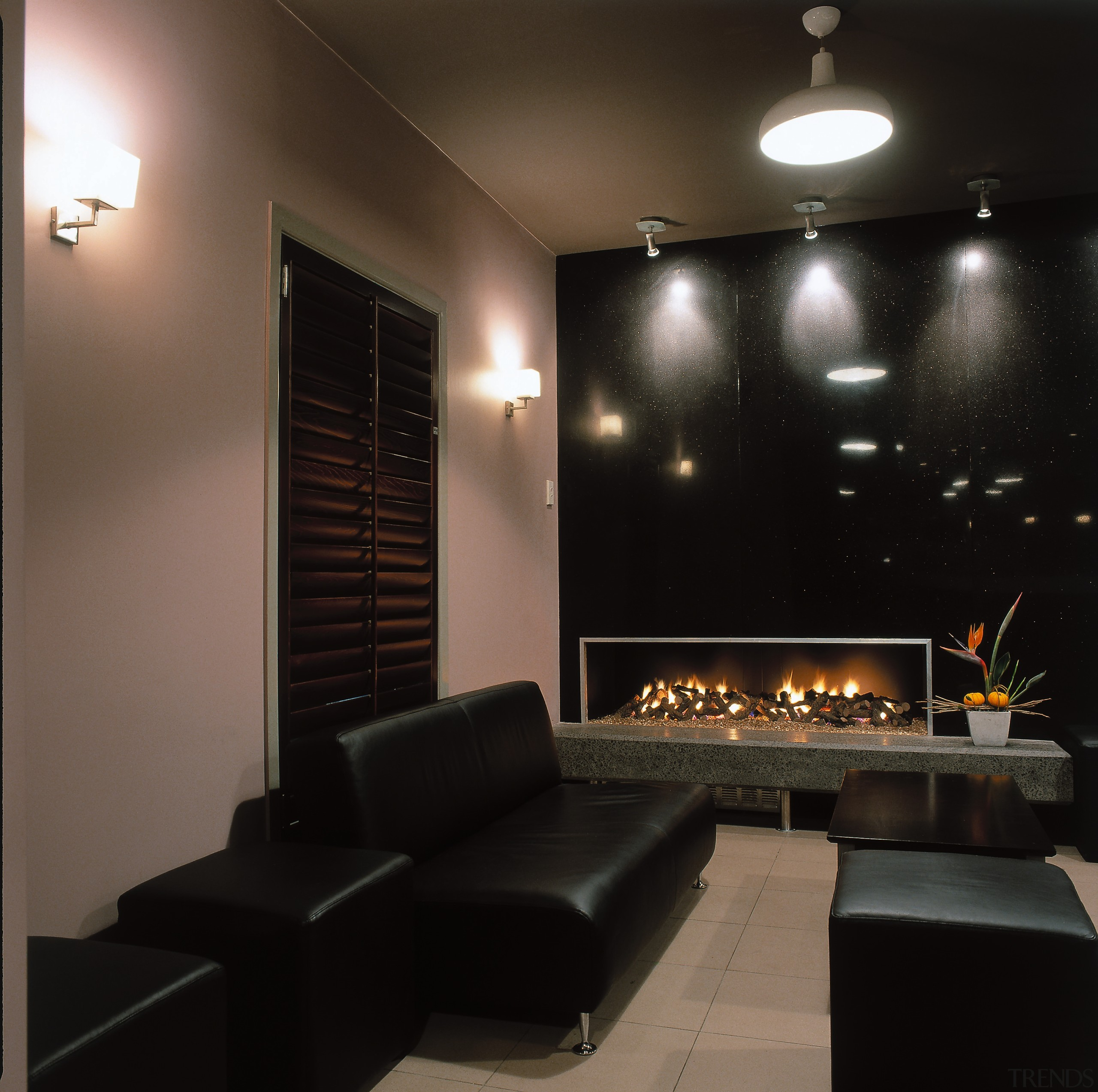 image of chill out area consisting of leater ceiling, interior design, light fixture, lighting, living room, wall, black