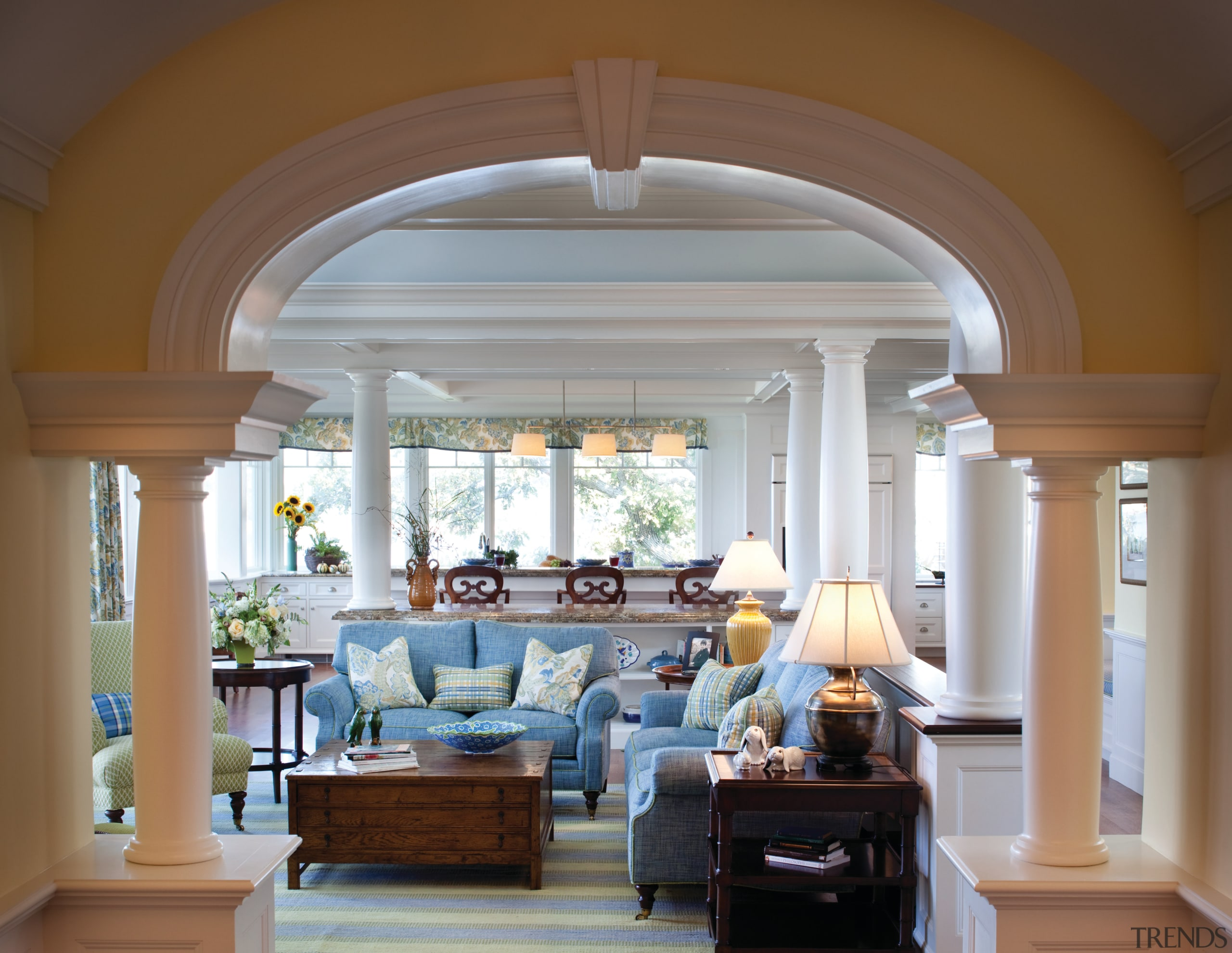 An expanded hallway now provides an easy transition arch, ceiling, column, estate, home, interior design, living room, real estate, structure, window, brown, gray