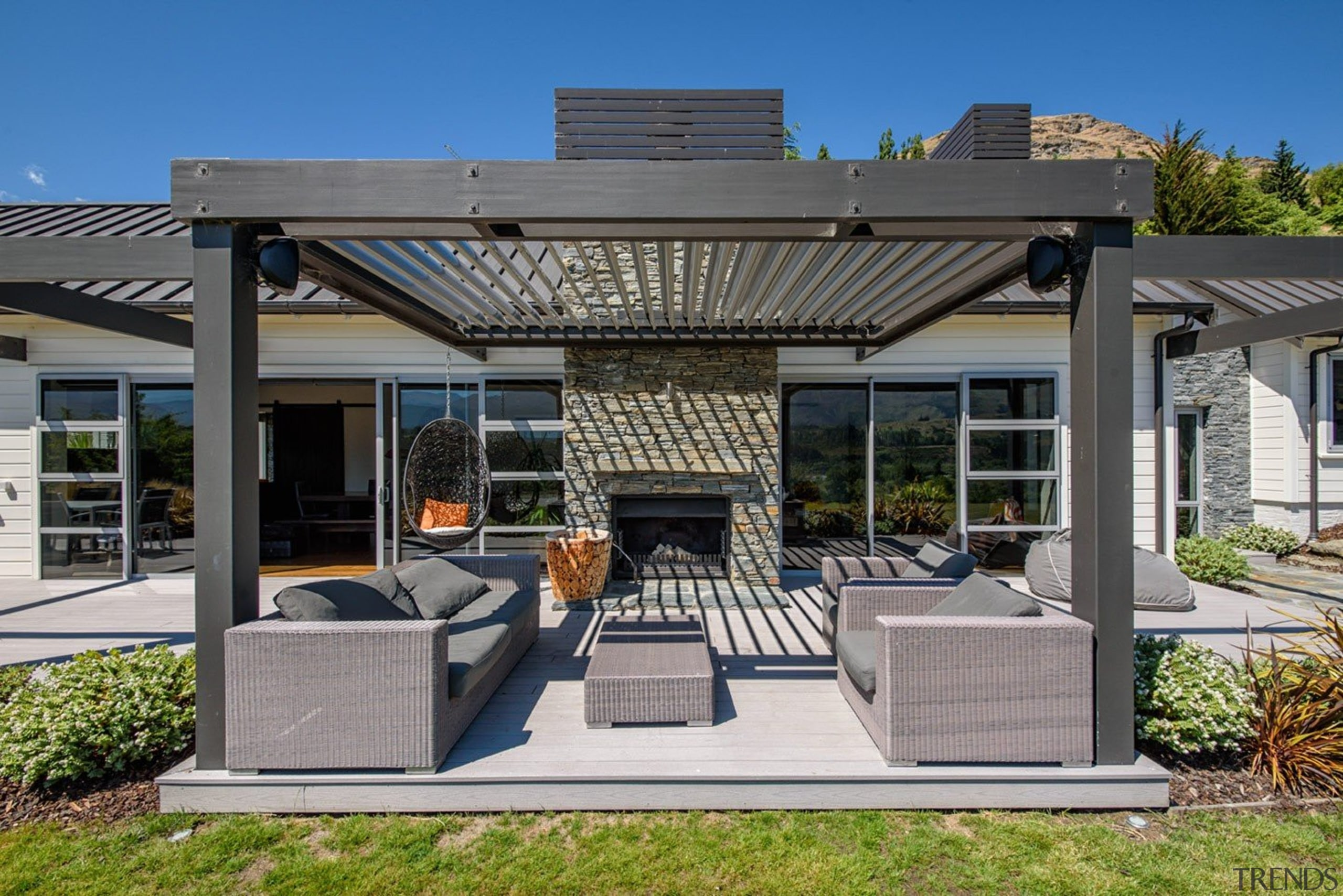 The word 'relax' comes to mind with this outdoor structure, real estate, gray
