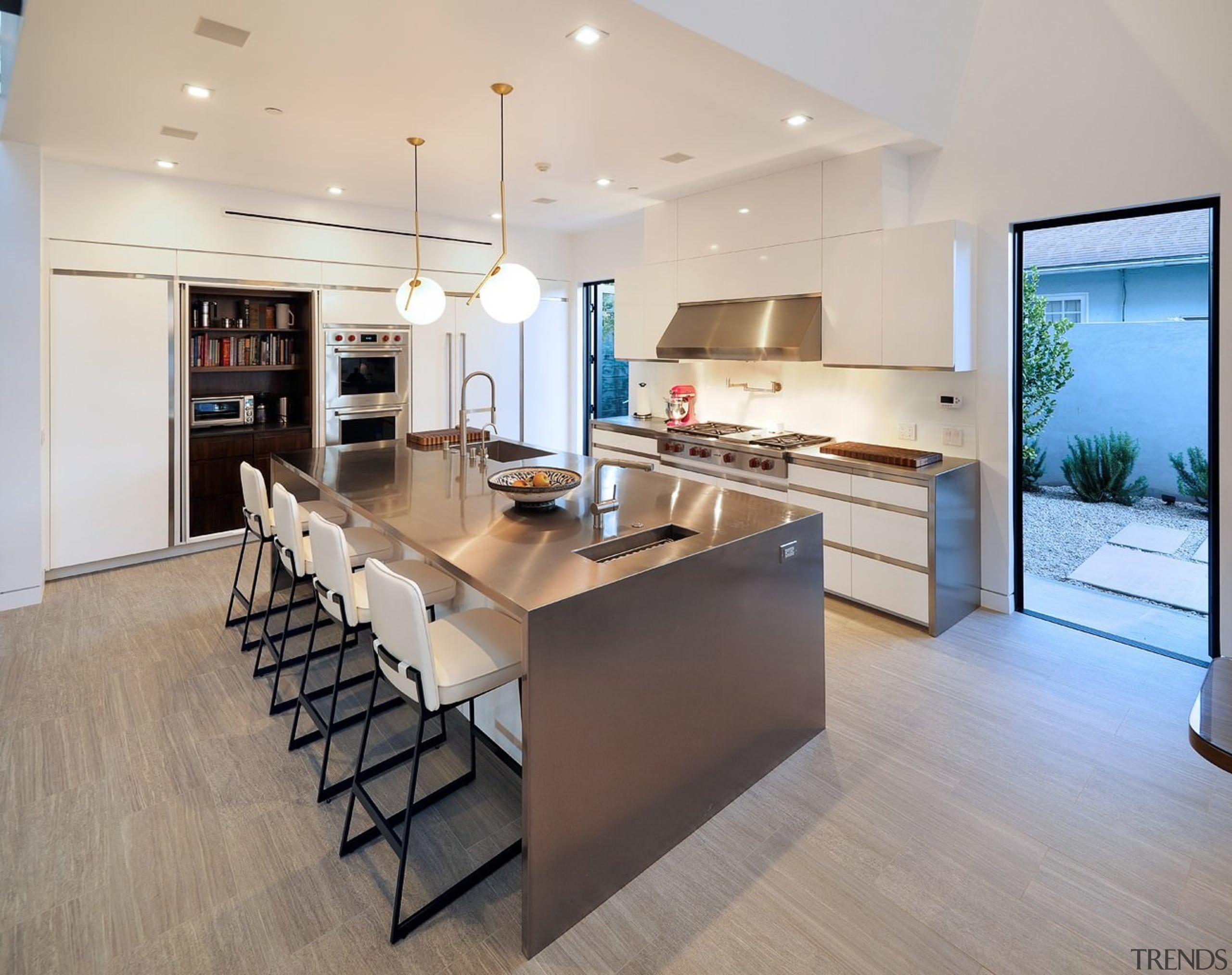 The island, with pendant lighting, is certainly the countertop, floor, flooring, interior design, kitchen, real estate, room, wood flooring, gray