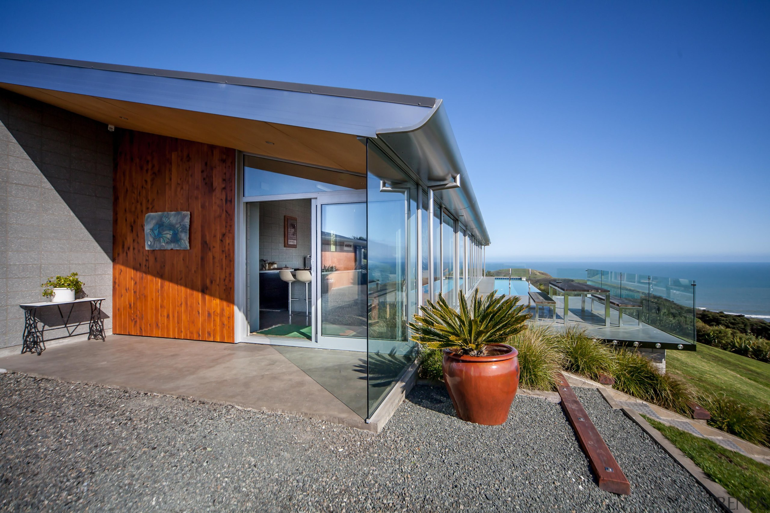 Capturing the spectacular views was a priority for architecture, cottage, estate, facade, home, house, property, real estate, villa, gray, blue