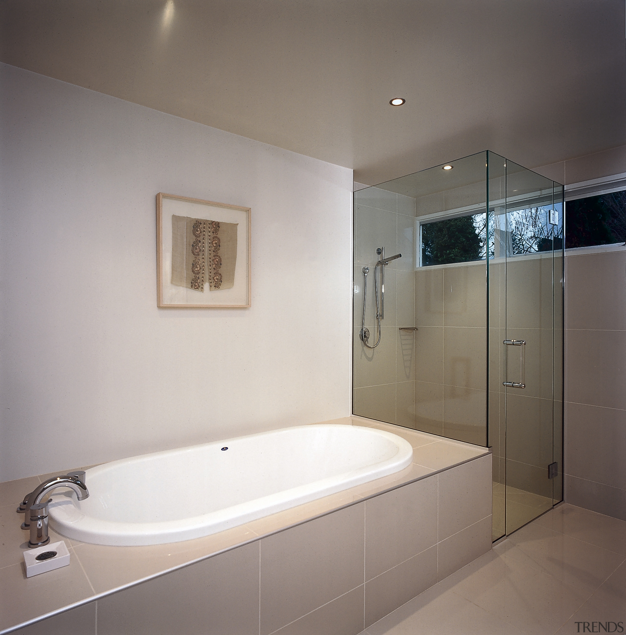 The view of a bathroom showing a bath bathroom, bathtub, floor, home, interior design, lighting, plumbing fixture, property, room, tile, gray
