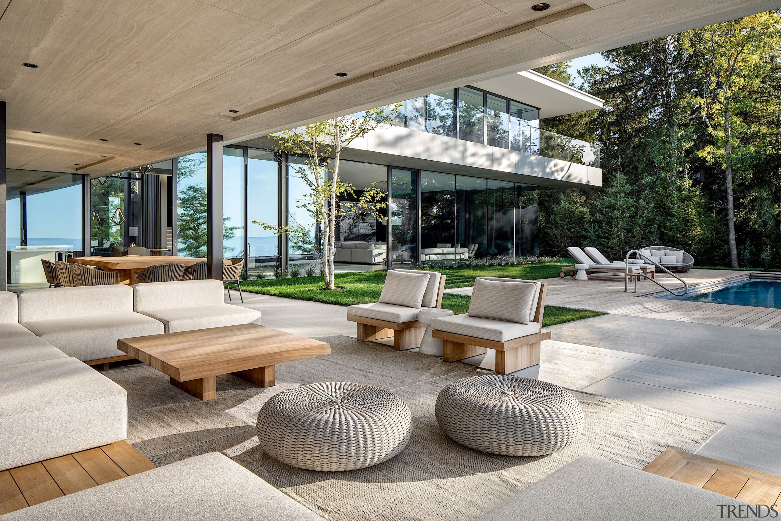 A covered outdoor entertainment area flanks a swimming