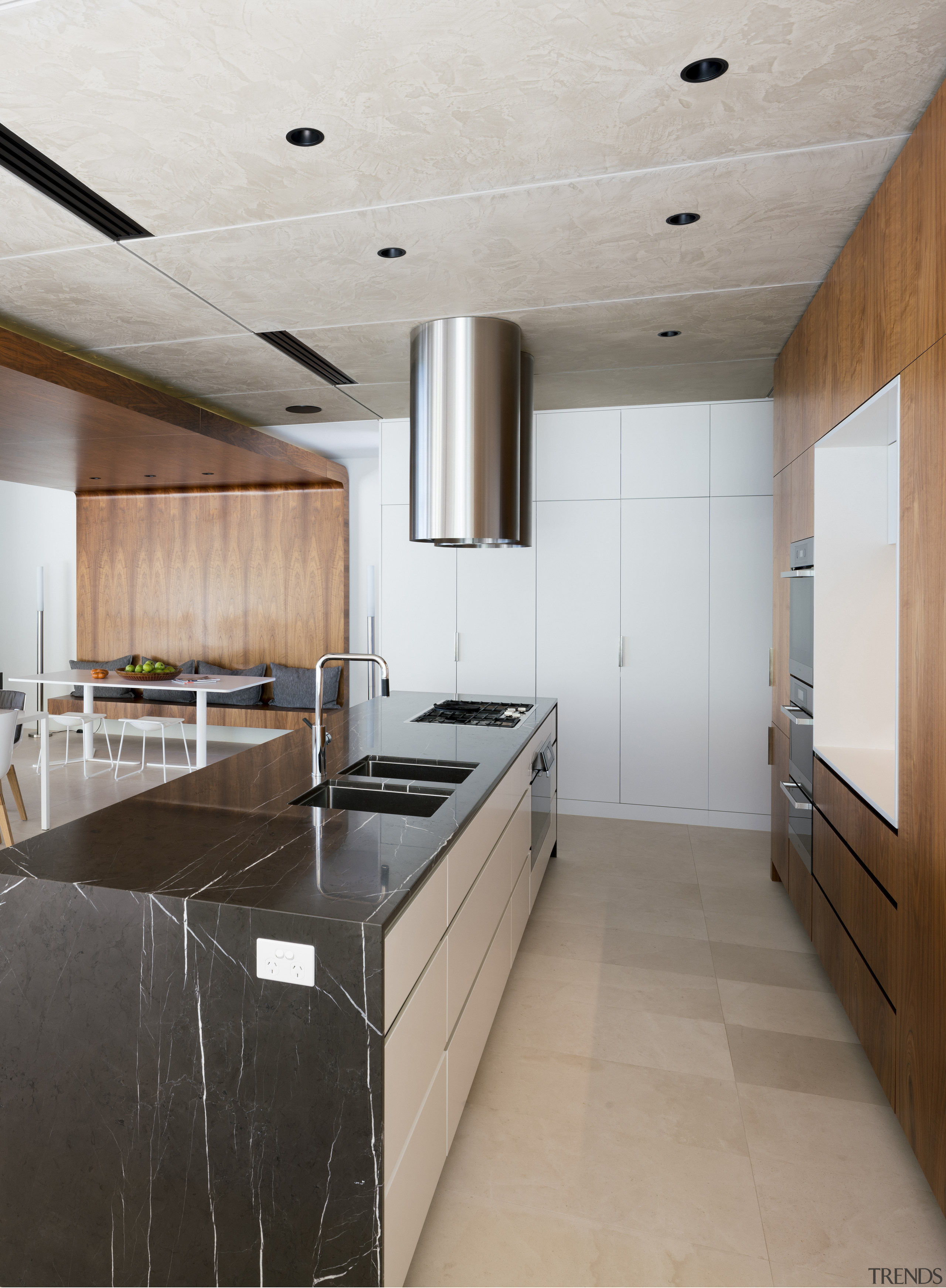 While this kitchen's components are designed to present architecture, cabinetry, ceiling, countertop, cuisine classique, floor, flooring, house, interior design, kitchen, real estate, room, wood flooring, gray