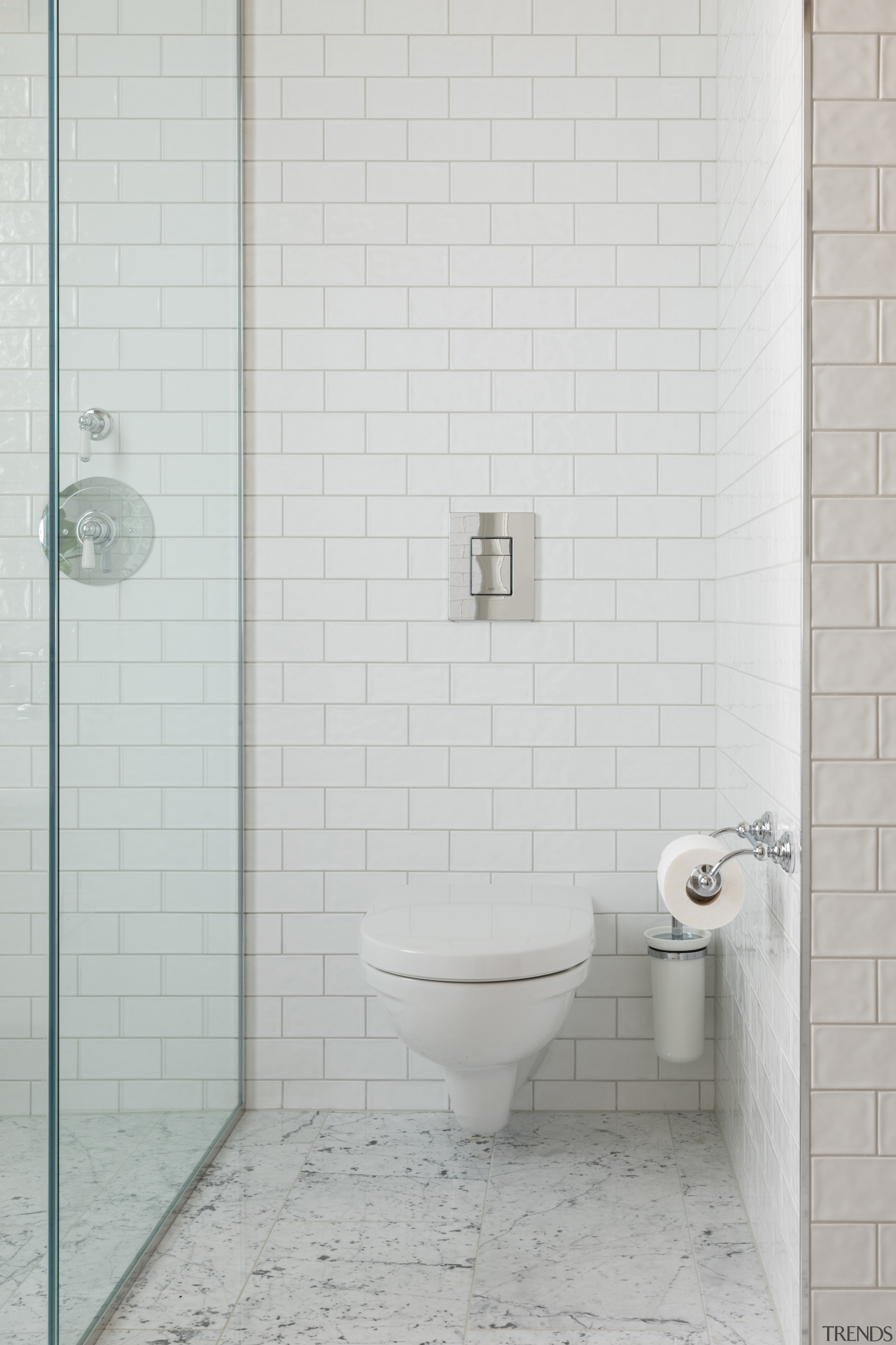 The toilet is tucked in beside the shower