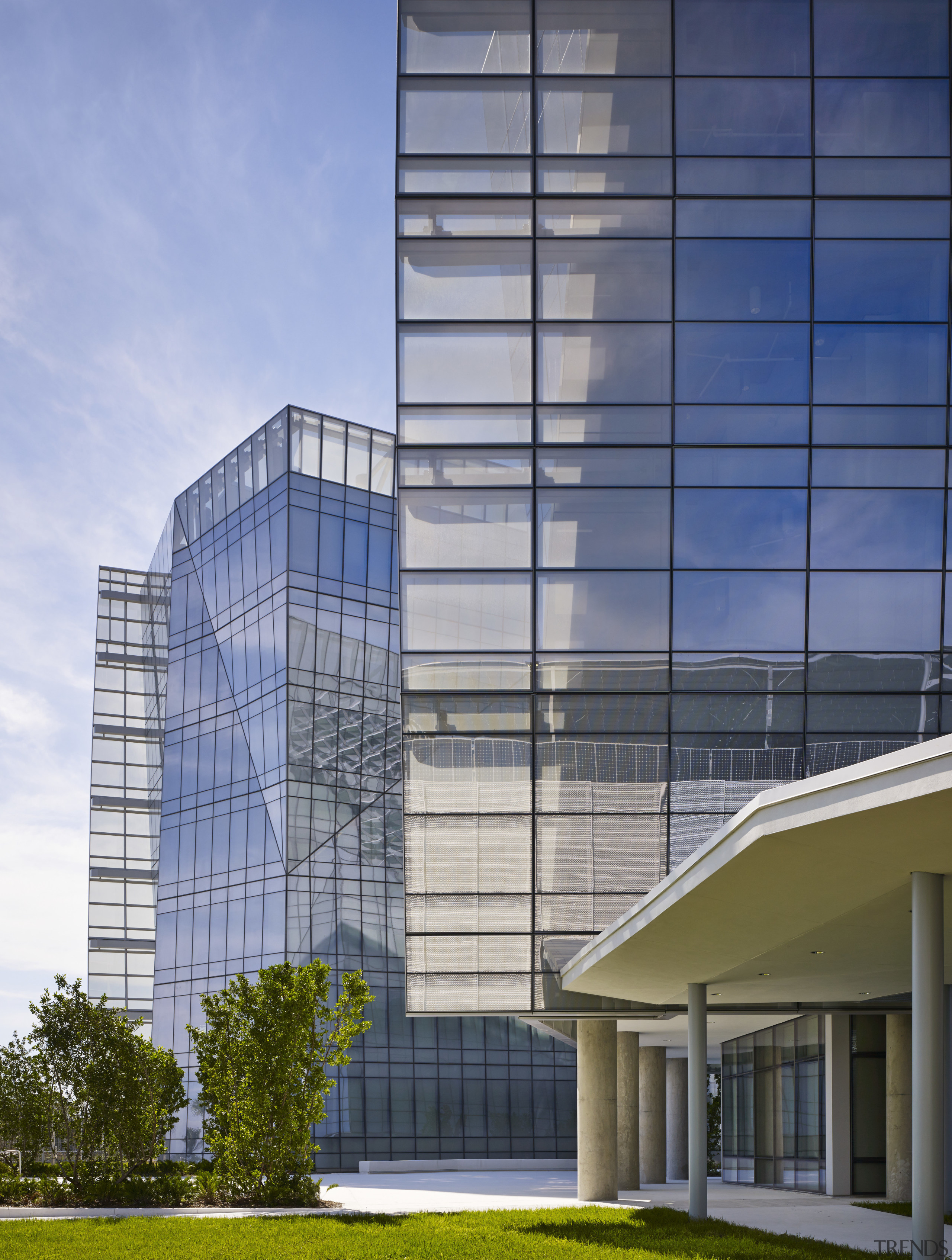 The reflective glass facade of the new Federal apartment, architecture, building, commercial building, condominium, corporate headquarters, daylighting, daytime, elevation, facade, headquarters, metropolis, metropolitan area, mixed use, real estate, residential area, sky, skyscraper, tower block, window, gray