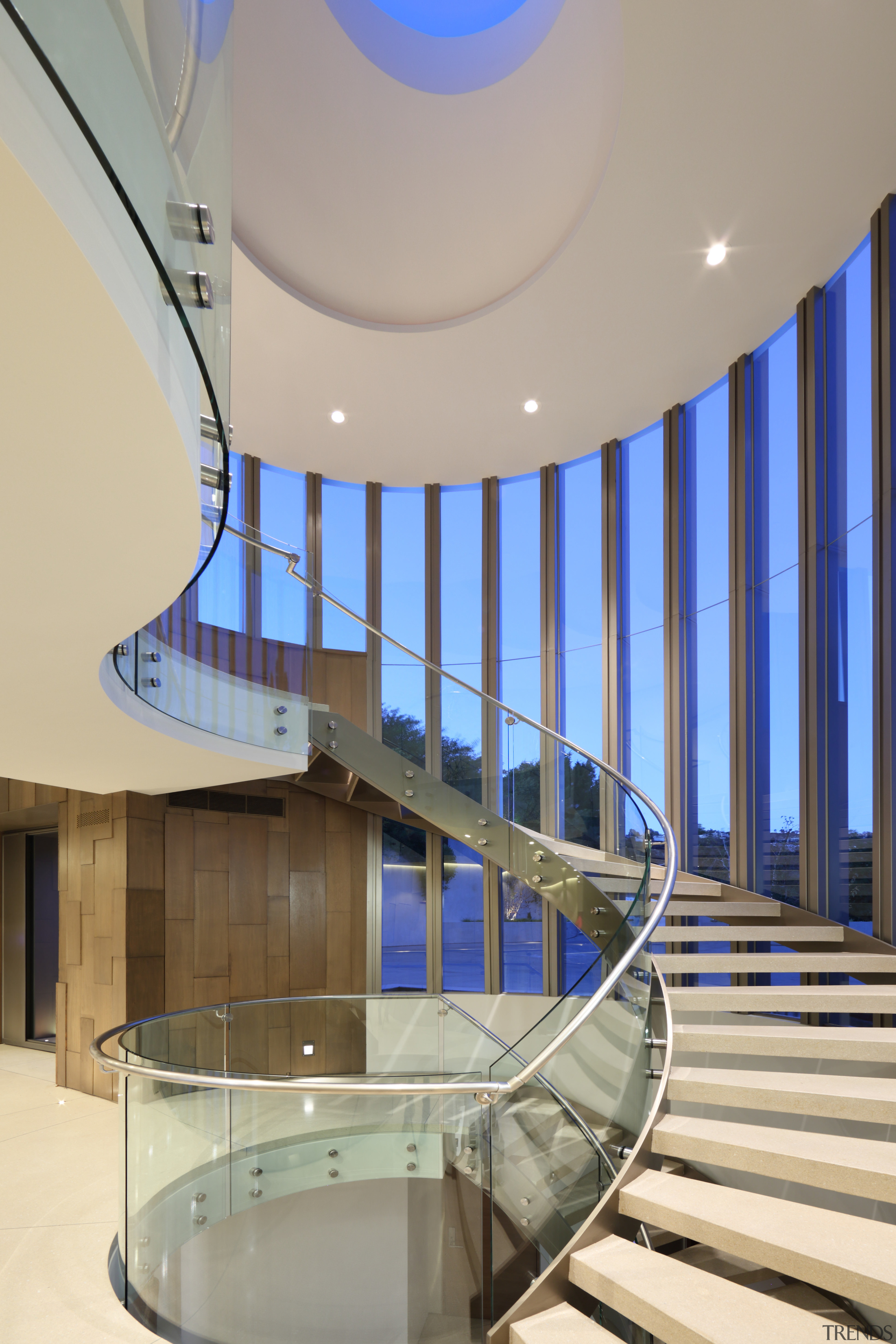 Nestled in the stair tower seen from the apartment, architecture, ceiling, daylighting, estate, glass, handrail, interior design, leisure centre, lobby, real estate, stairs, structure, gray