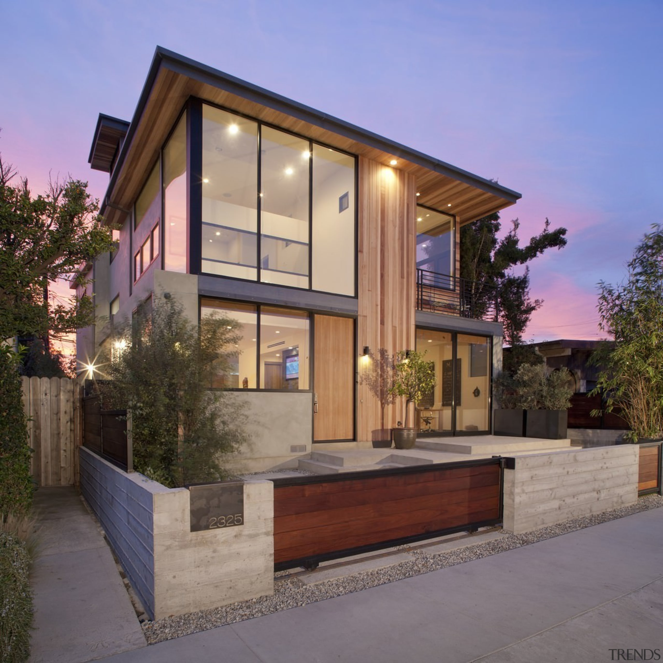Outside, the home is inviting, with substantial windows architecture, elevation, estate, facade, home, house, property, real estate, residential area, siding, window, gray
