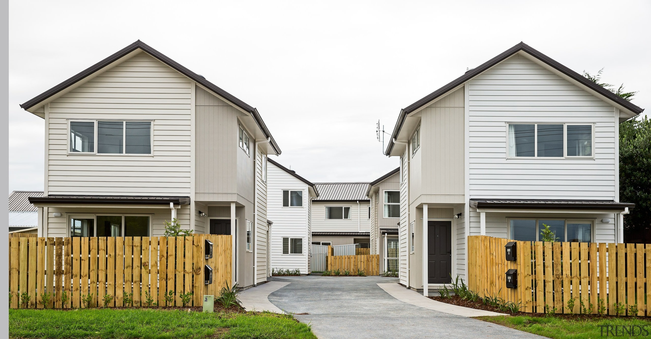Eight new homes in the Richardson-Howell development, owned building, cottage, elevation, estate, facade, farmhouse, home, house, neighbourhood, property, real estate, residential area, siding, suburb, white