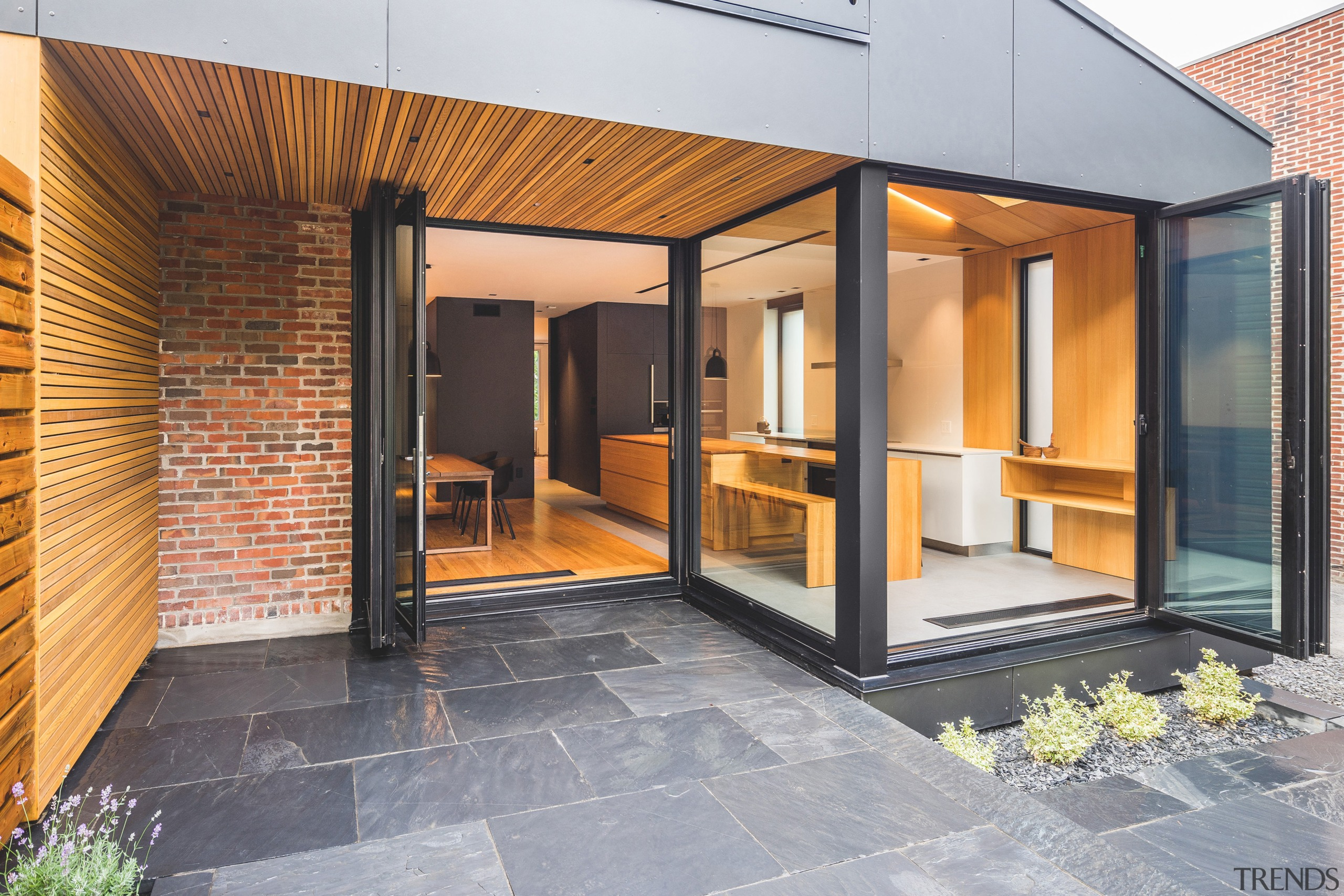 Architect Natalie Dionne says the reconfiguration of outdated architecture, door, facade, home, house, property, real estate, window, gray