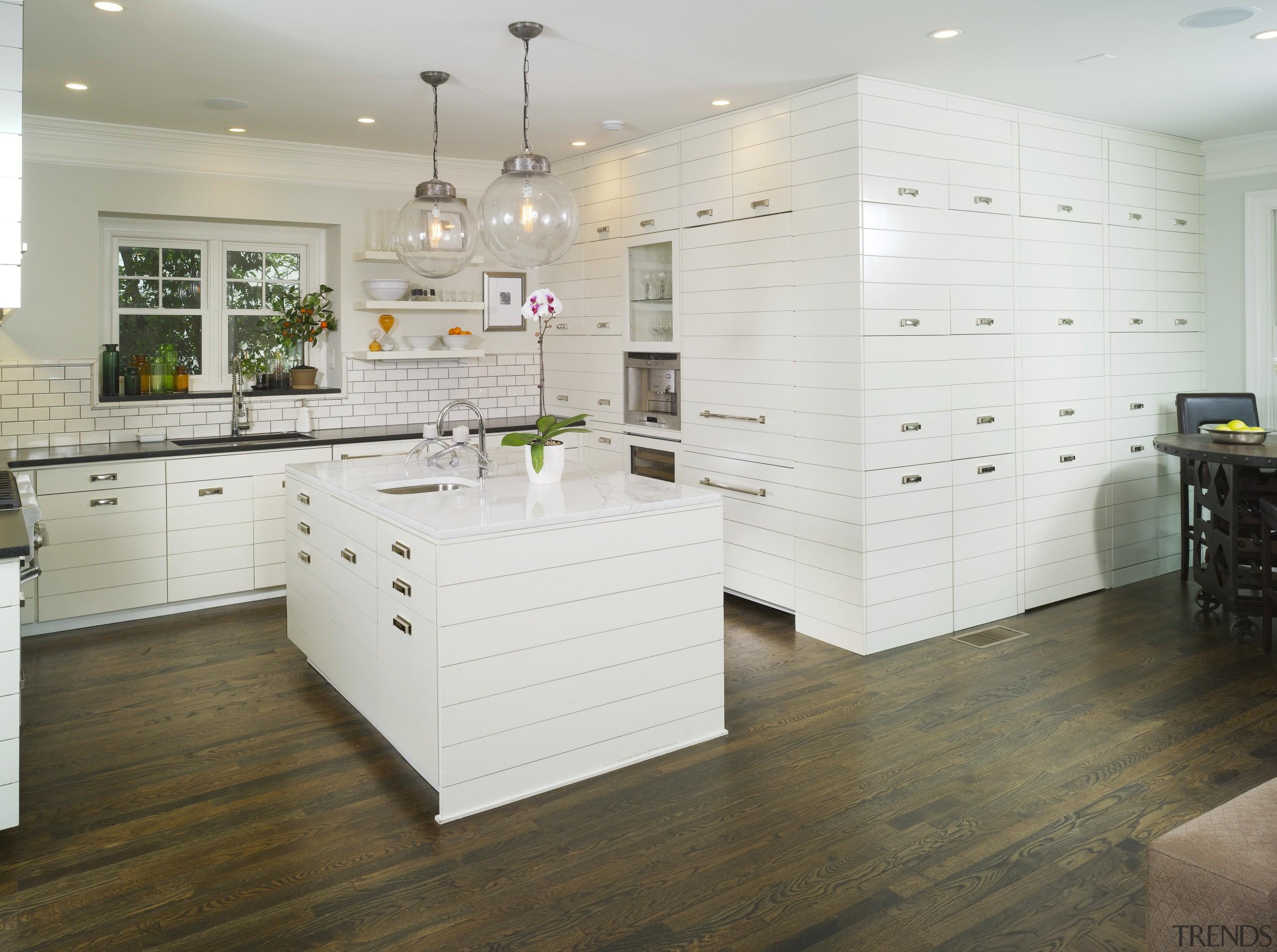 View of kitchen by Designer Willis Watts. Remodelled cabinetry, countertop, floor, flooring, furniture, hardwood, interior design, kitchen, laminate flooring, room, tile, wall, wood, wood flooring, white, gray
