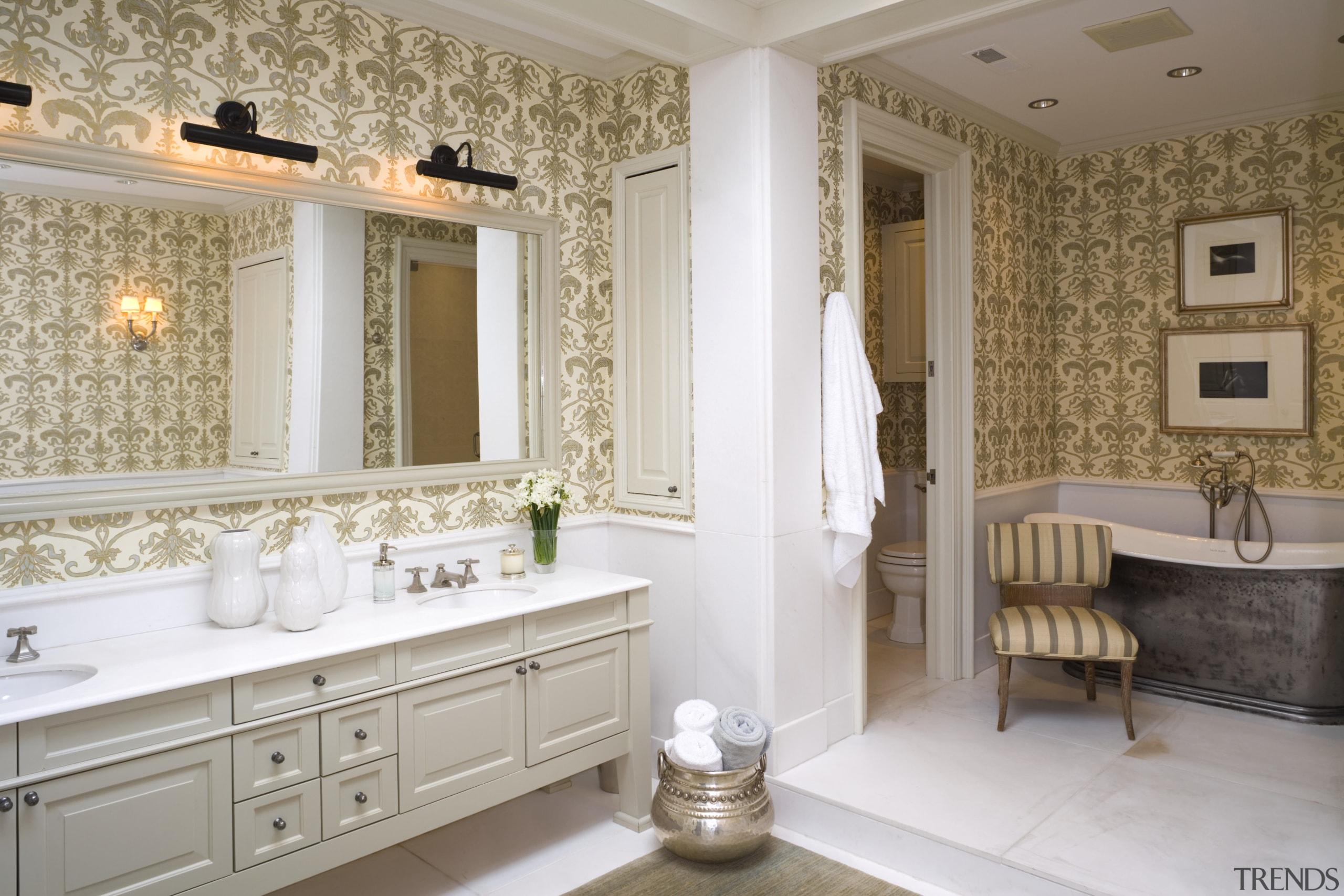 view of bathroom featuring bath tub, bathroom cabinetry, bathroom, bathroom accessory, ceiling, floor, flooring, home, interior design, room, tile, wall, window, gray, brown