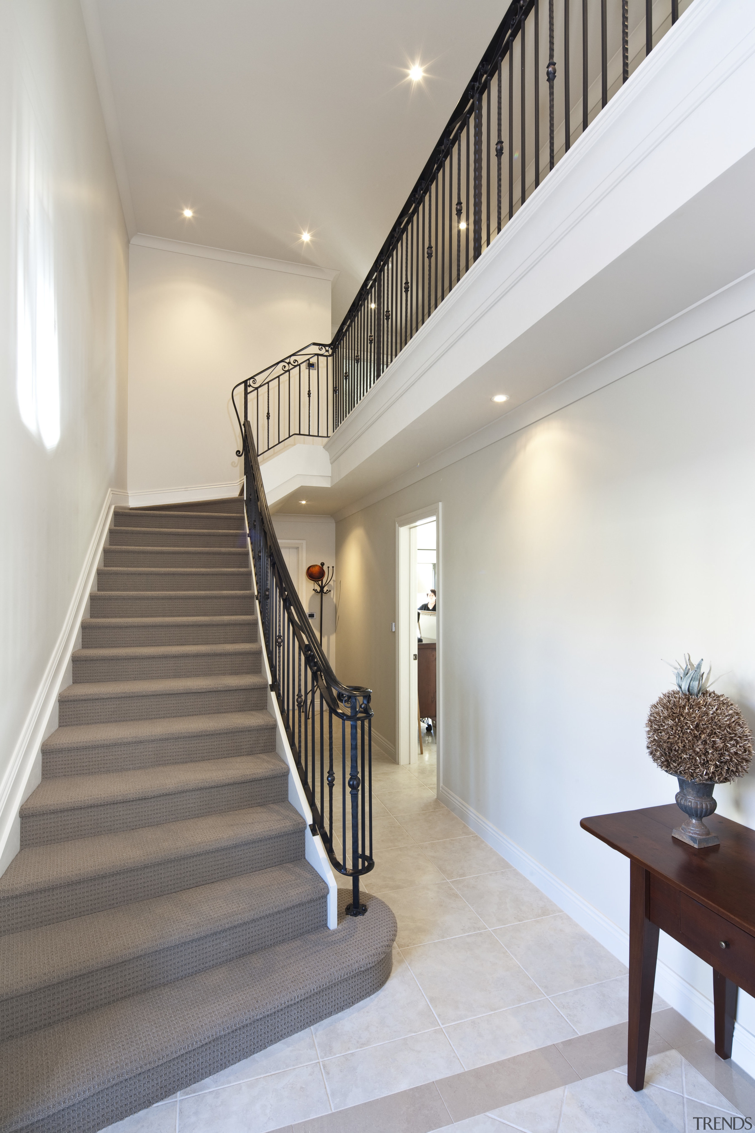View of stairway which features iron balustrade and architecture, baluster, ceiling, daylighting, estate, floor, flooring, handrail, home, house, interior design, real estate, stairs, gray, white