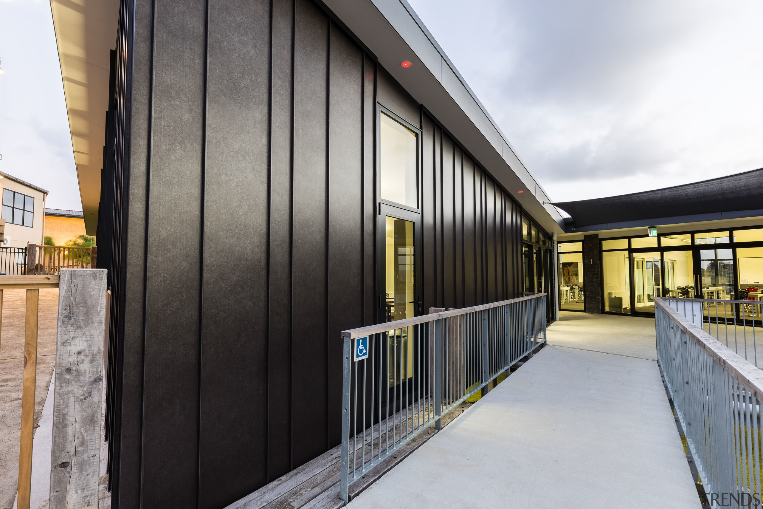 The panelling between the standing seam elements on architecture, building, facade, house, real estate, gray, black, white