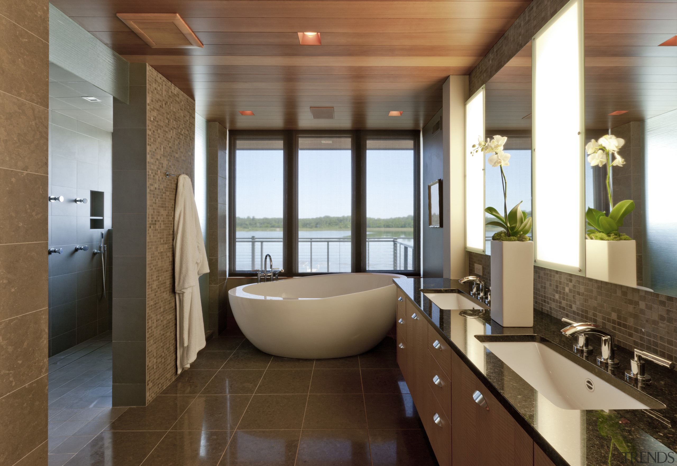 big white bathtub at far end of galley-style architecture, bathroom, ceiling, estate, floor, interior design, lobby, real estate, room, brown
