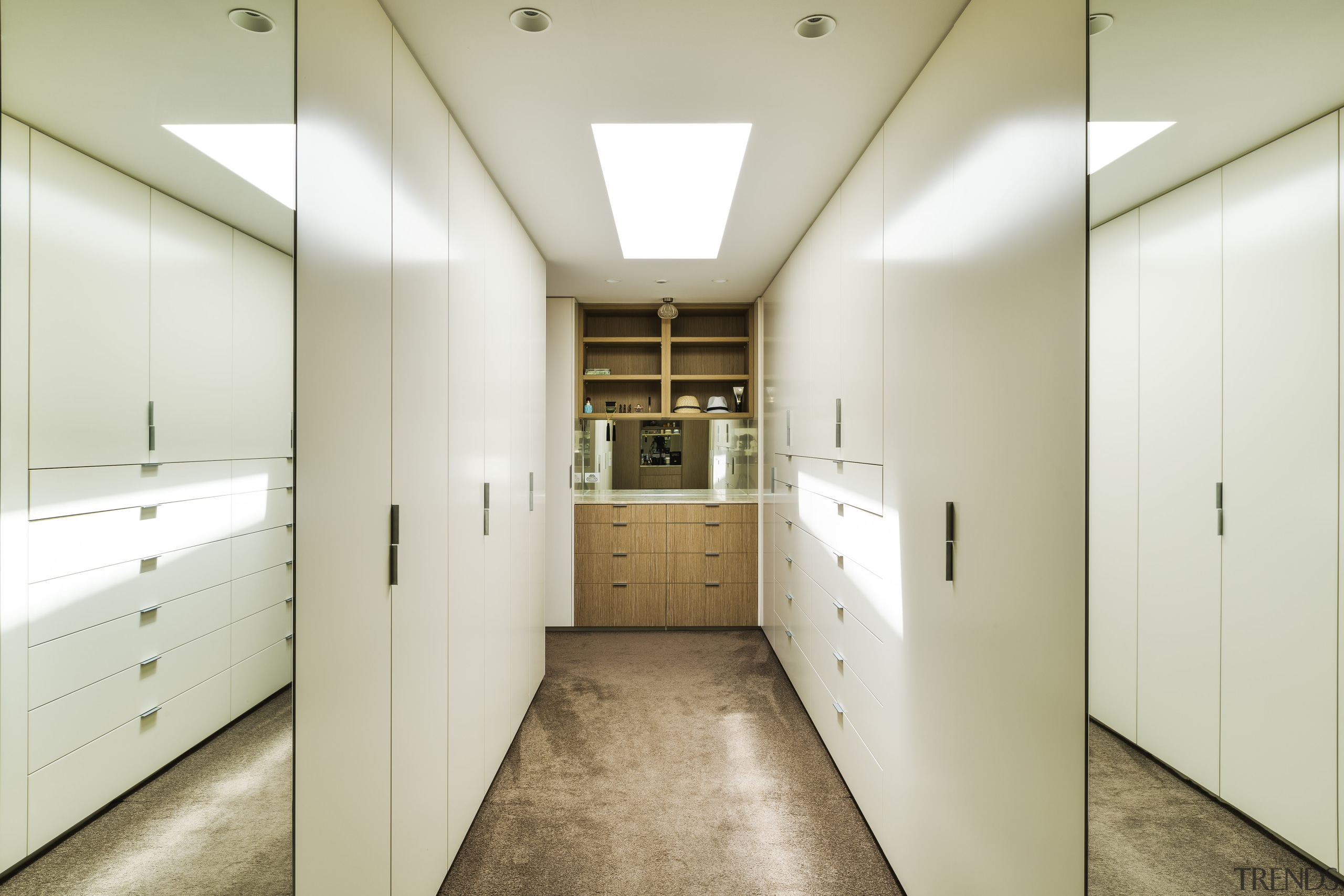 Wall mirrors extend the sense of space in floor, interior design, master suite, dressing room, mirrors, cabinetry, Giles & Tribe Architecture
