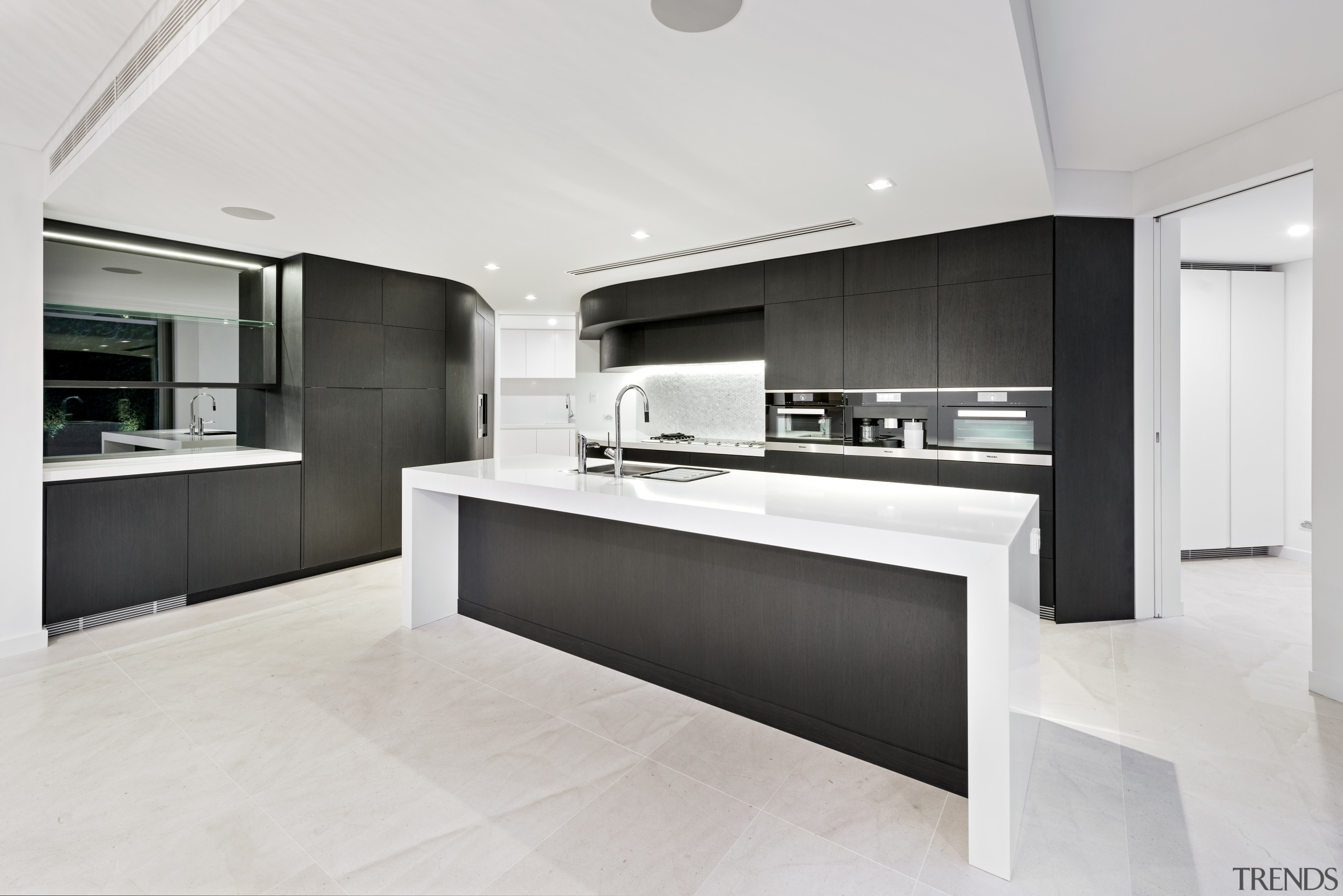 While this kitchen is in black and white, countertop, interior design, kitchen, real estate, white
