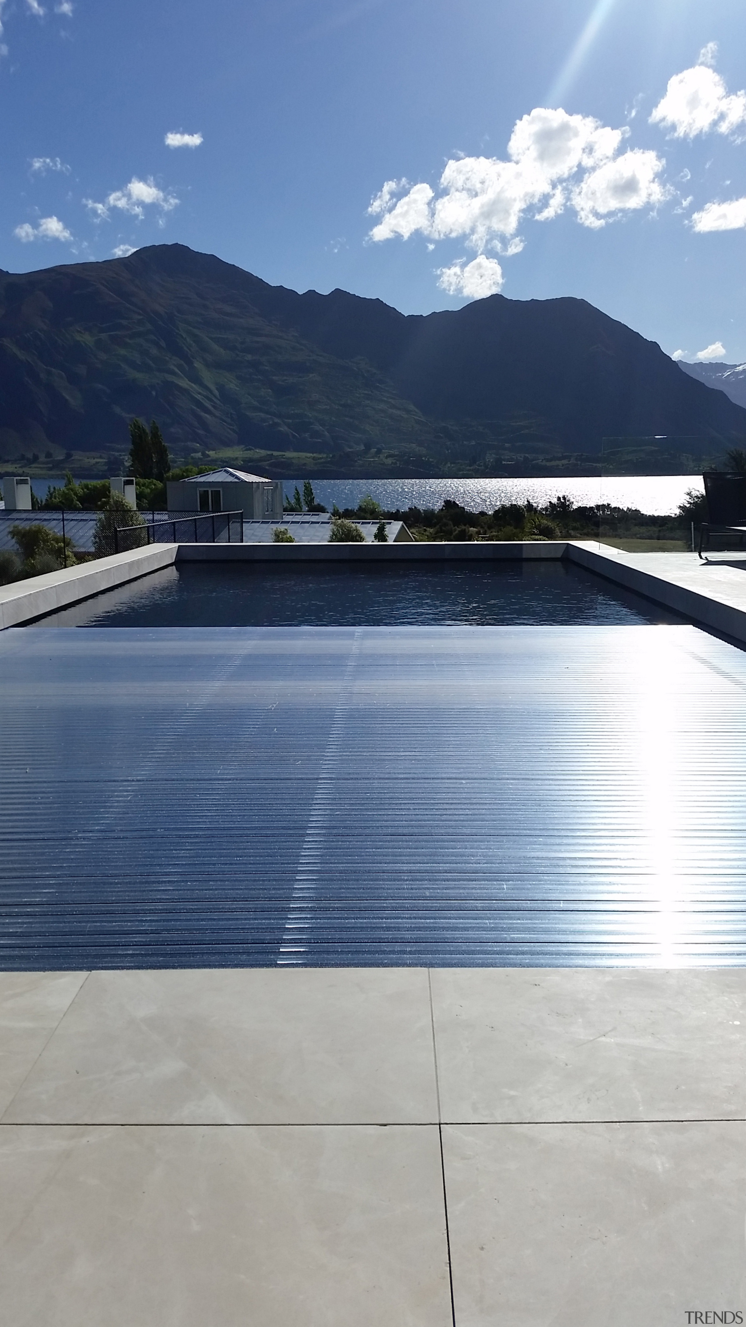Roll Out Roll Under slatted covers are a reflection, reservoir, water, covers 4 pools, swimming pool