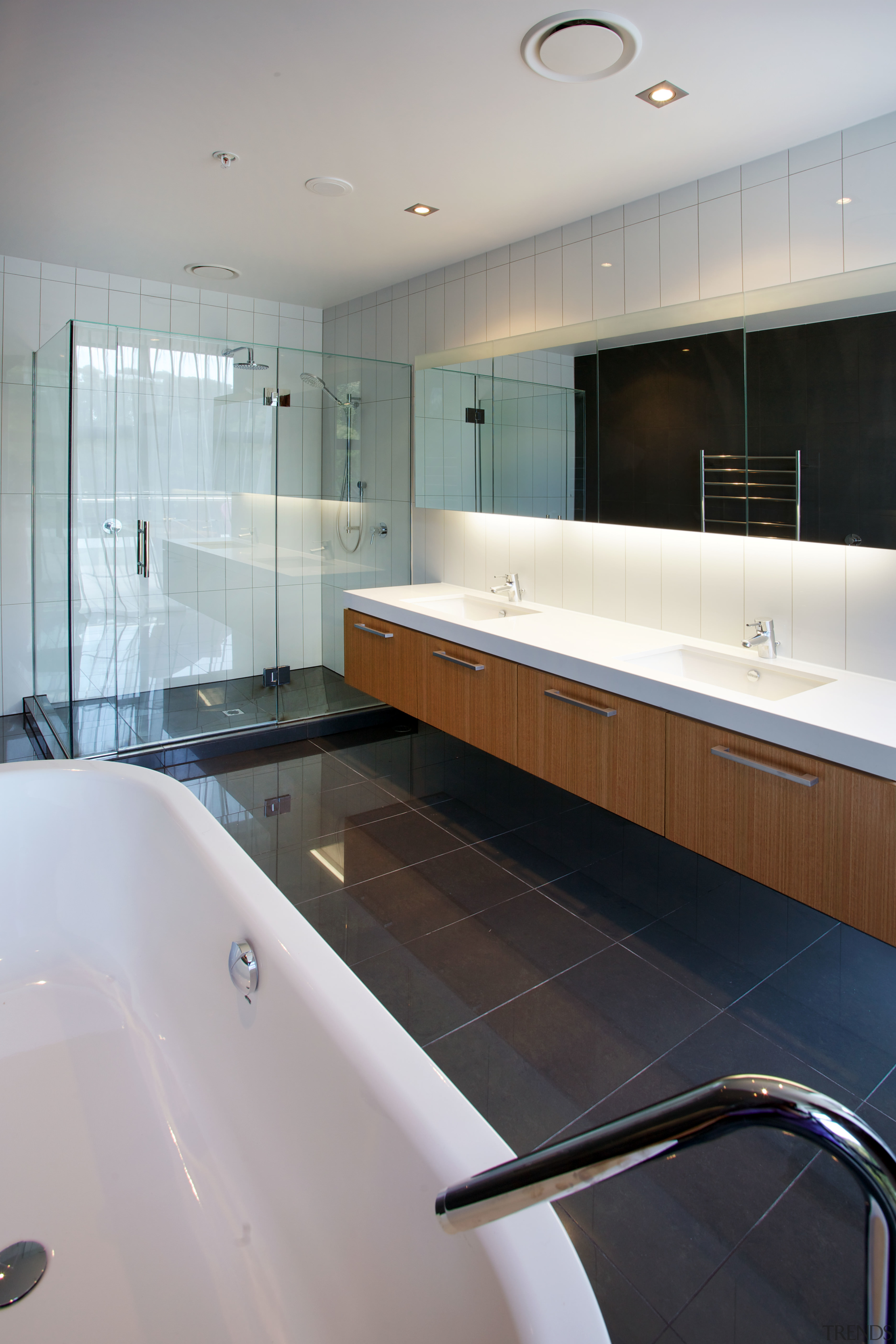 Spacious master bathrooms are a feature of the architecture, bathroom, bathtub, floor, interior design, property, room, sink, tile, gray