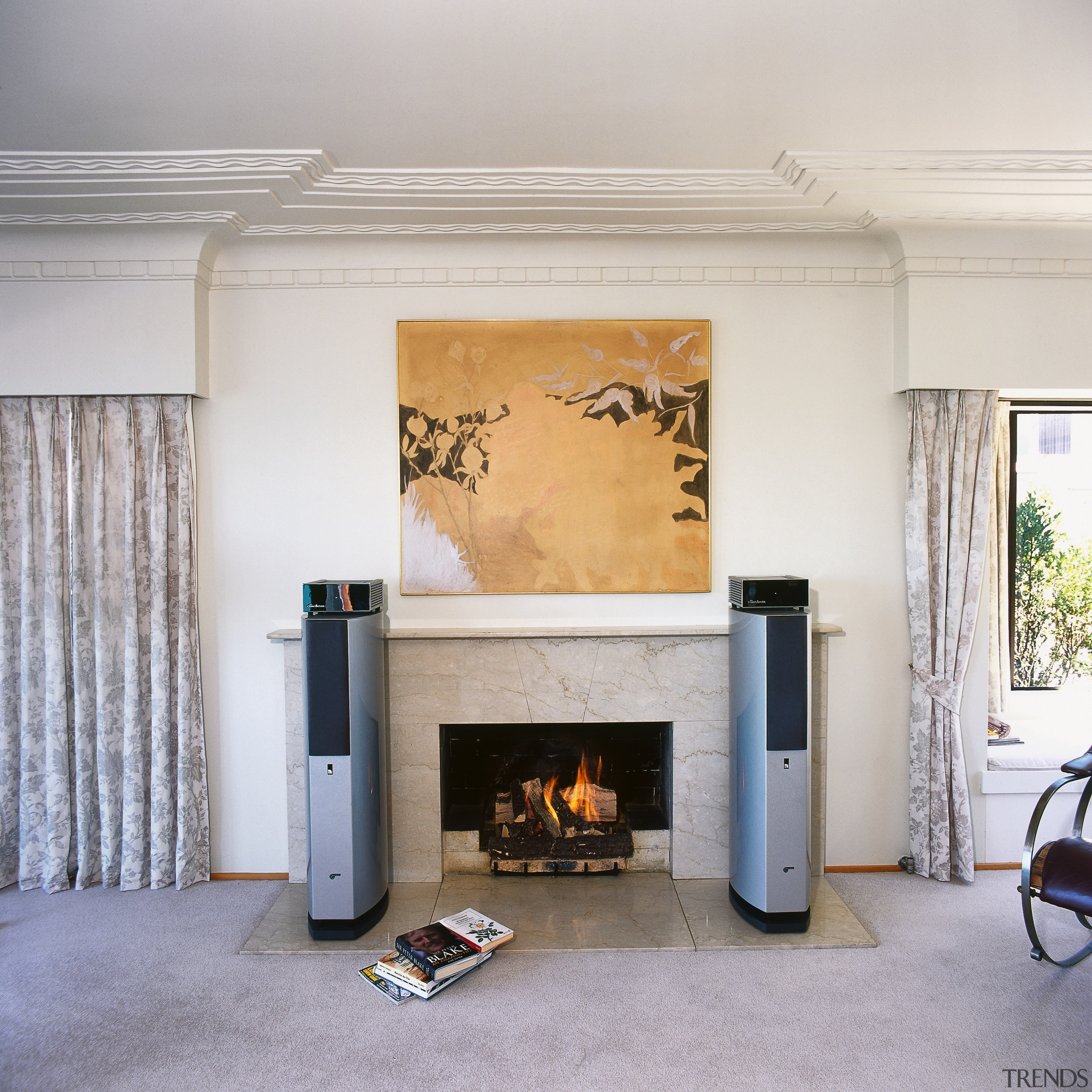 view of the bravo fx-10 speakers that are fireplace, floor, hearth, home, interior design, living room, wood burning stove, gray