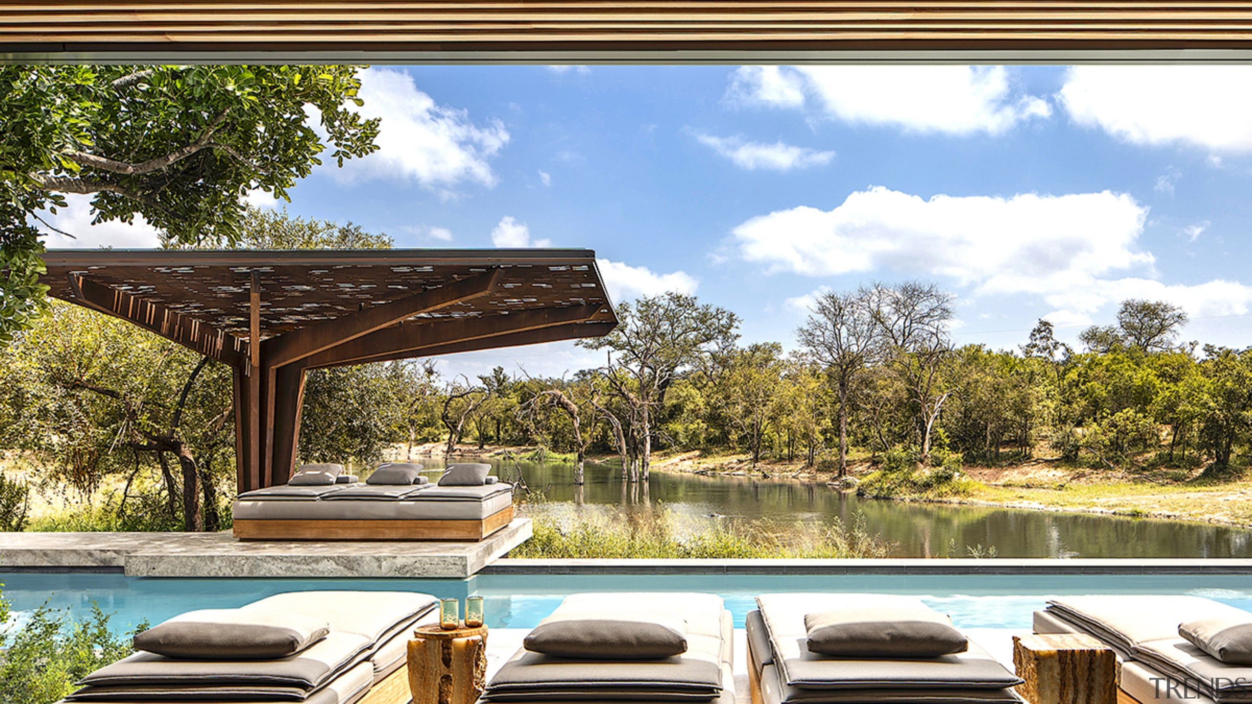At the new Cheetah Plains lodge in Kruger backyard, building, deck, furniture, home, house, interior design, landscape, landscaping, leisure, natural landscape, outdoor furniture, patio, property, real estate, room, shade, table, tree, brown, white