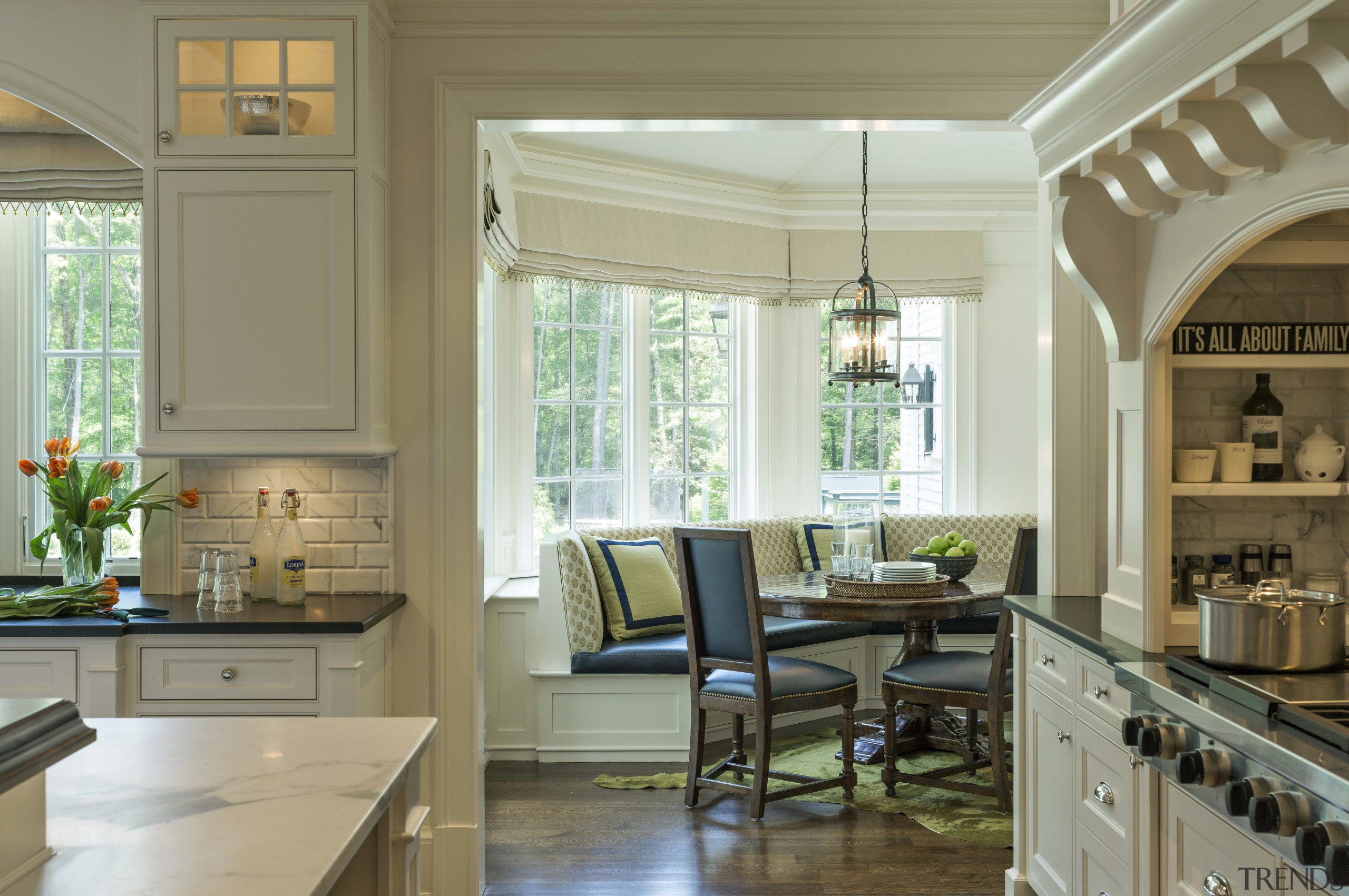 This glass-walled pavilion-style breakfast room in a New cabinetry, ceiling, countertop, cuisine classique, home, interior design, kitchen, living room, room, window, brown, gray