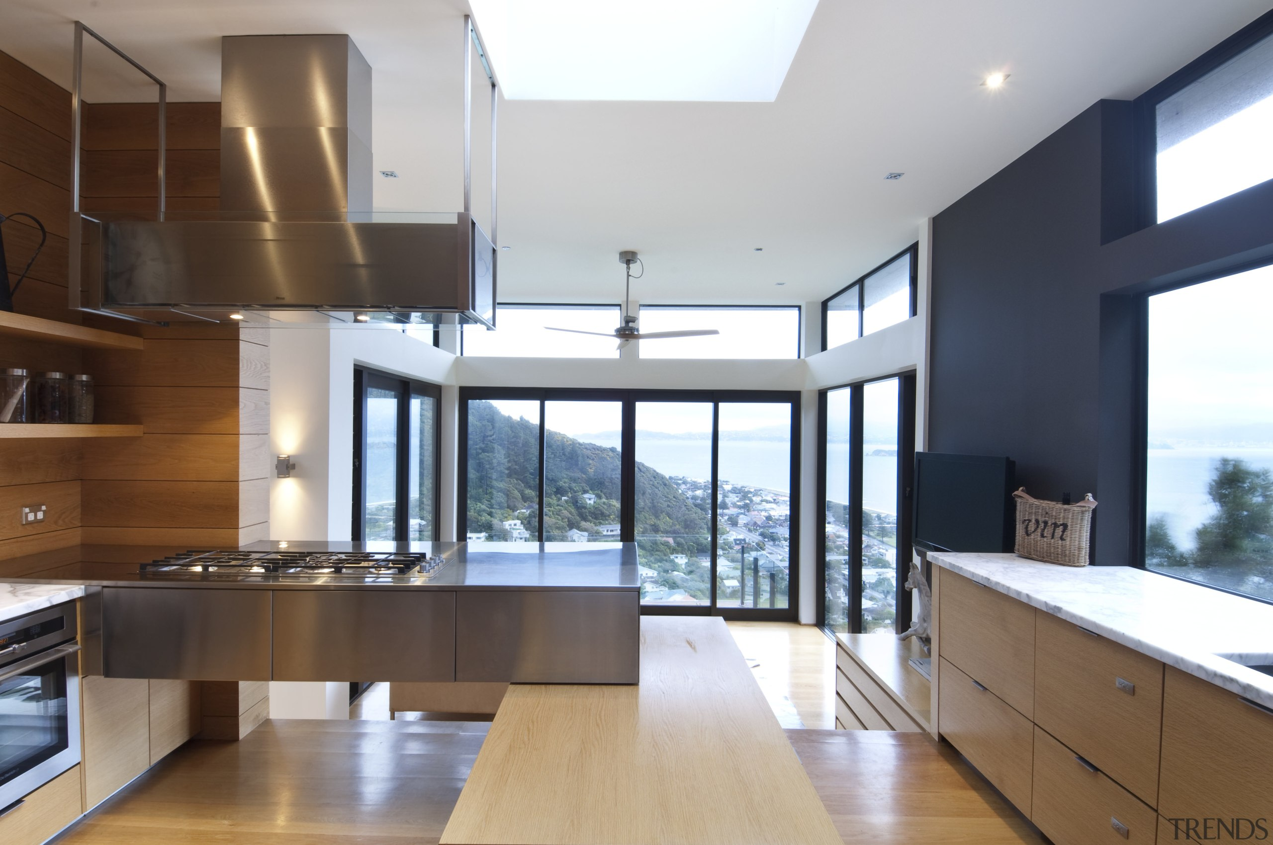 View of kitchen which features oak floors, and architecture, countertop, daylighting, interior design, kitchen, real estate, white, brown