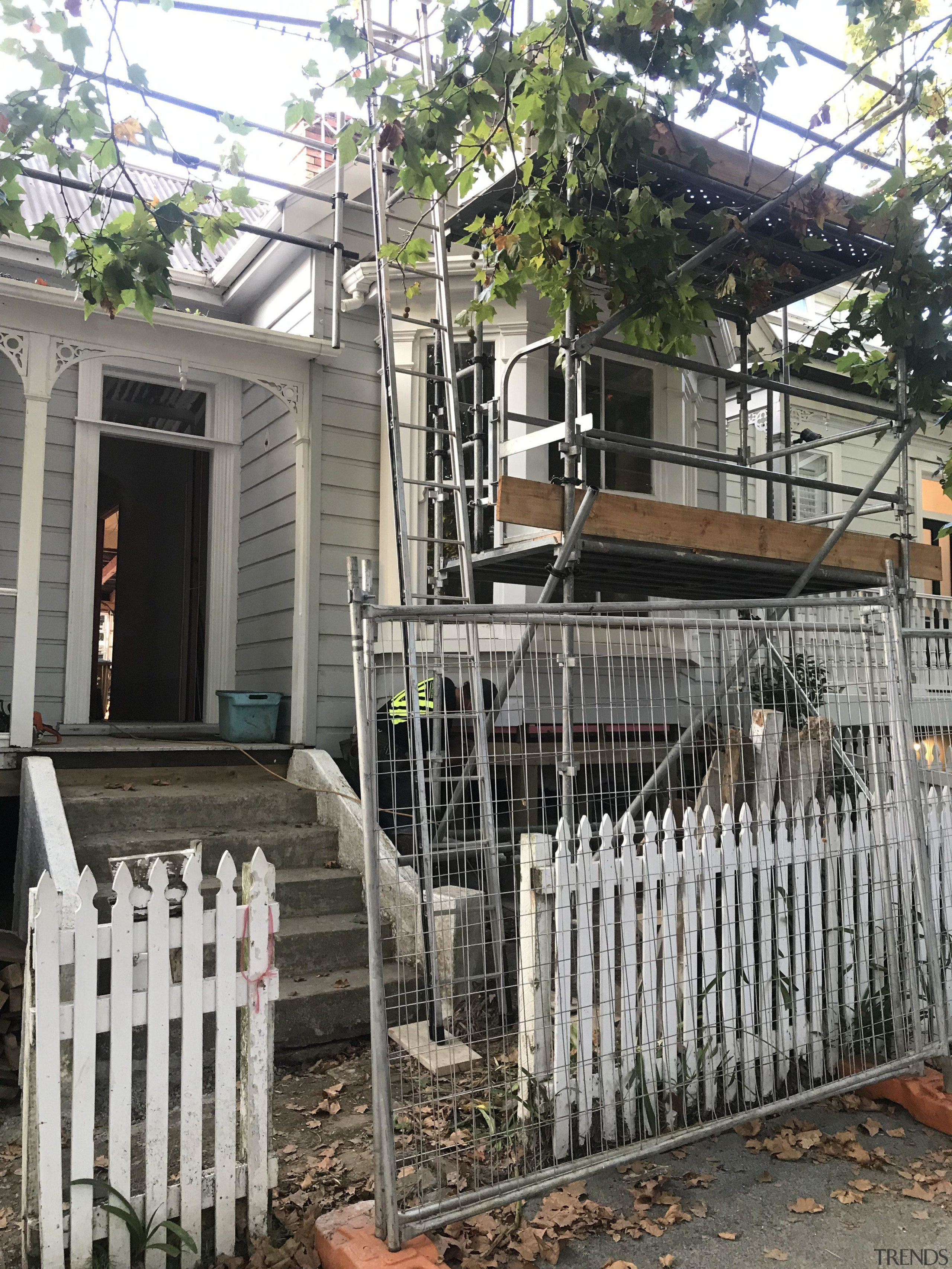 Scaffholding is all up and the new roof architecture, building, fence, home, house, iron, metal, tree, gray, black