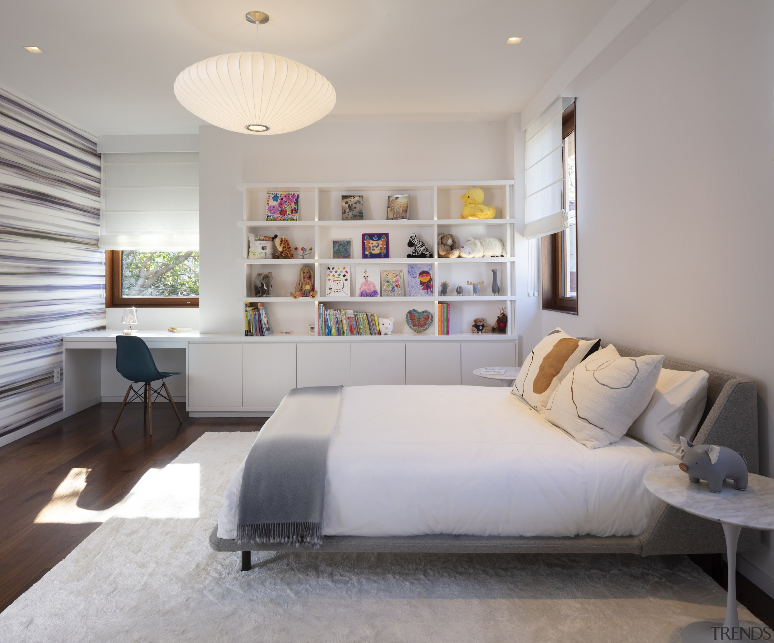 This child's bedroom includes built-in display shelving and