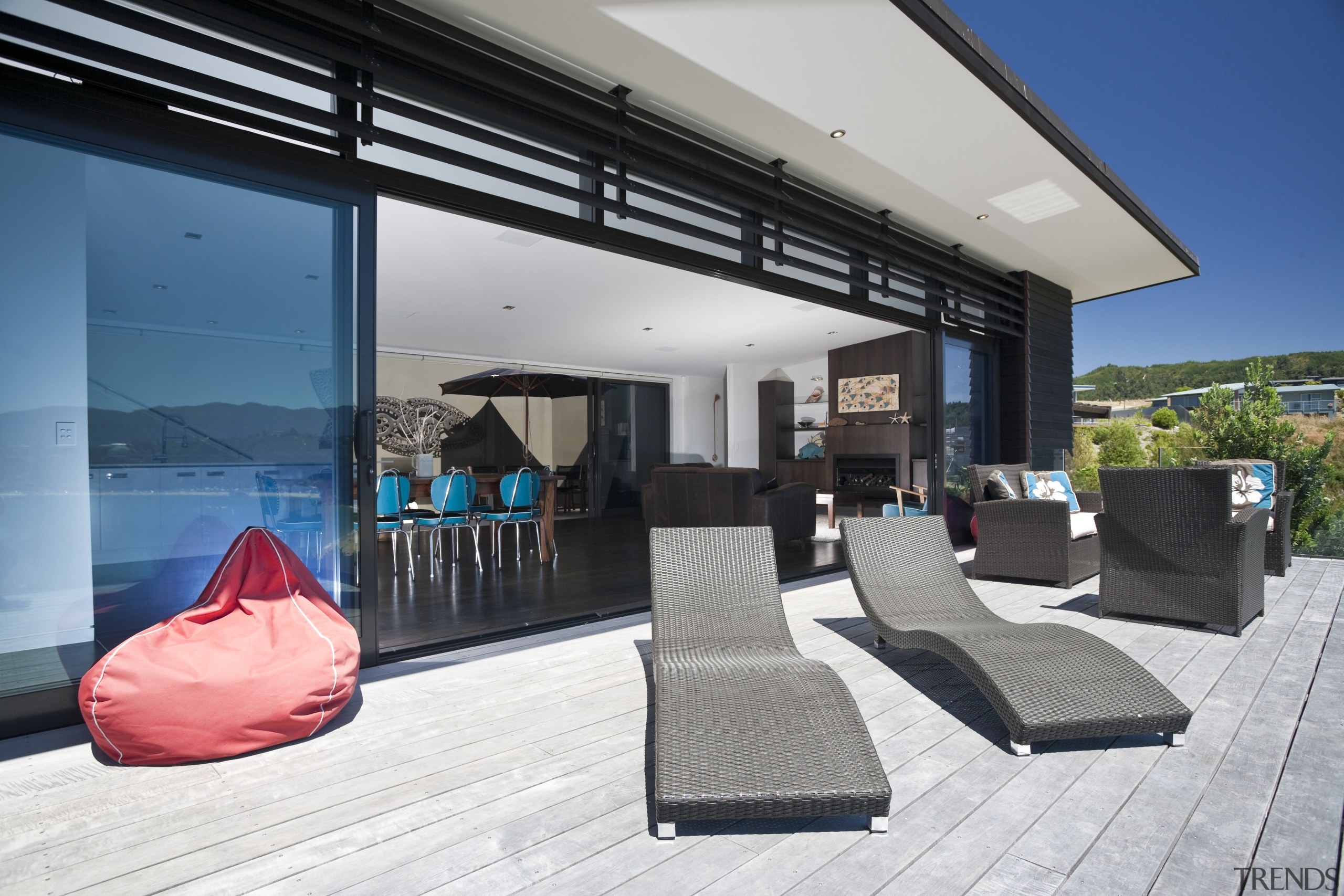 View of the outdoor living space which features architecture, home, house, interior design, property, real estate, window, gray