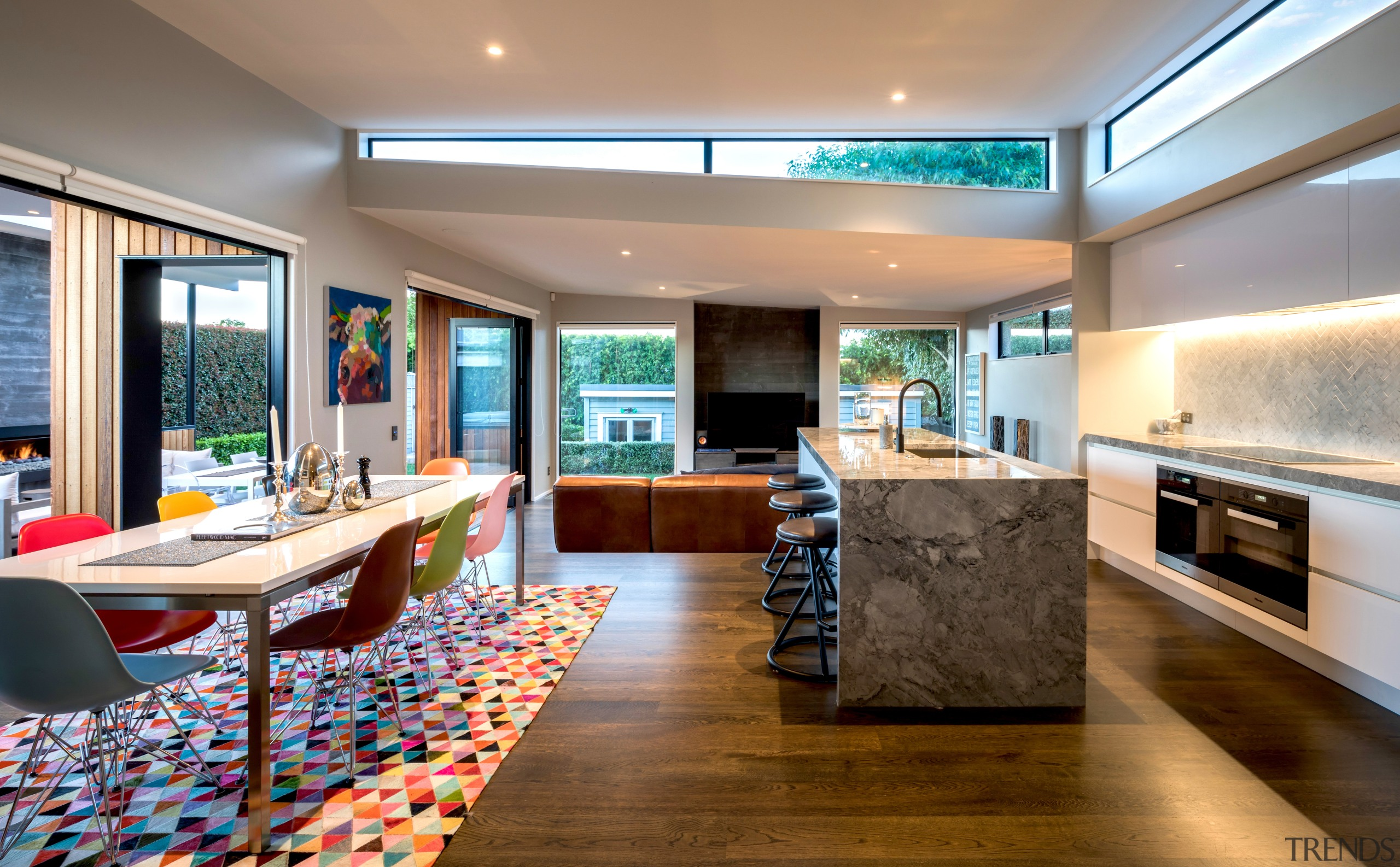A pop-up roof over the kitchen/dining space provides architecture, building, cabinetry, ceiling, countertop, design, floor, flooring, furniture, hardwood, home, house, interior design, kitchen, lighting, living room, property, real estate, room, table, wood flooring, gray