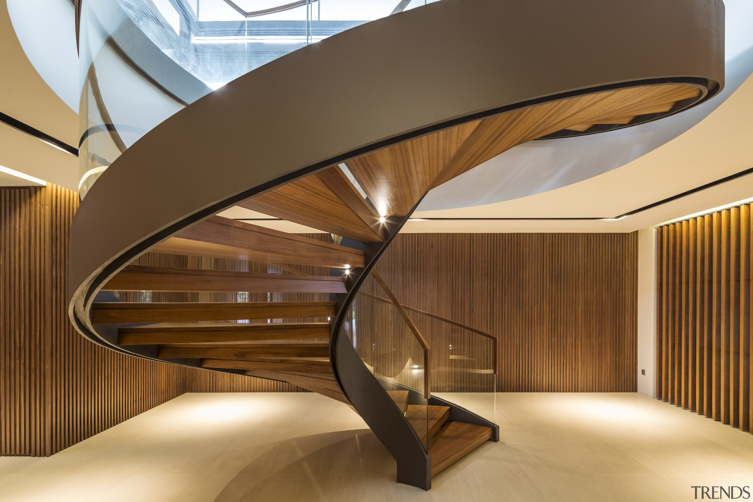 A timber-lined lobby containing a dramatic steel and architecture, ceiling, daylighting, interior design, lobby, product design, stairs, wood, brown