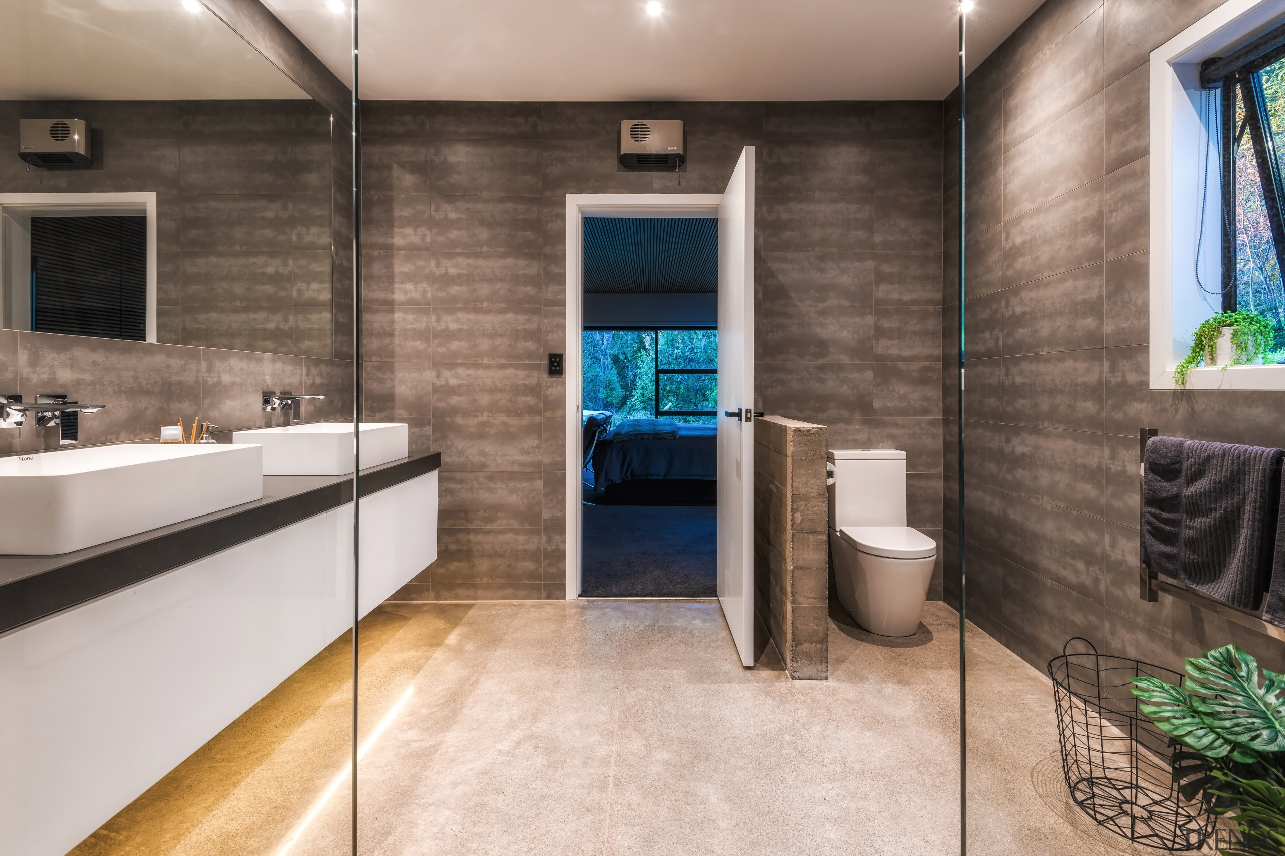 A low raw concrete nib wall provides some bathroom, floor, flooring, interior design, tile, gray, master suite, Kirsty Davis, vanity, shower