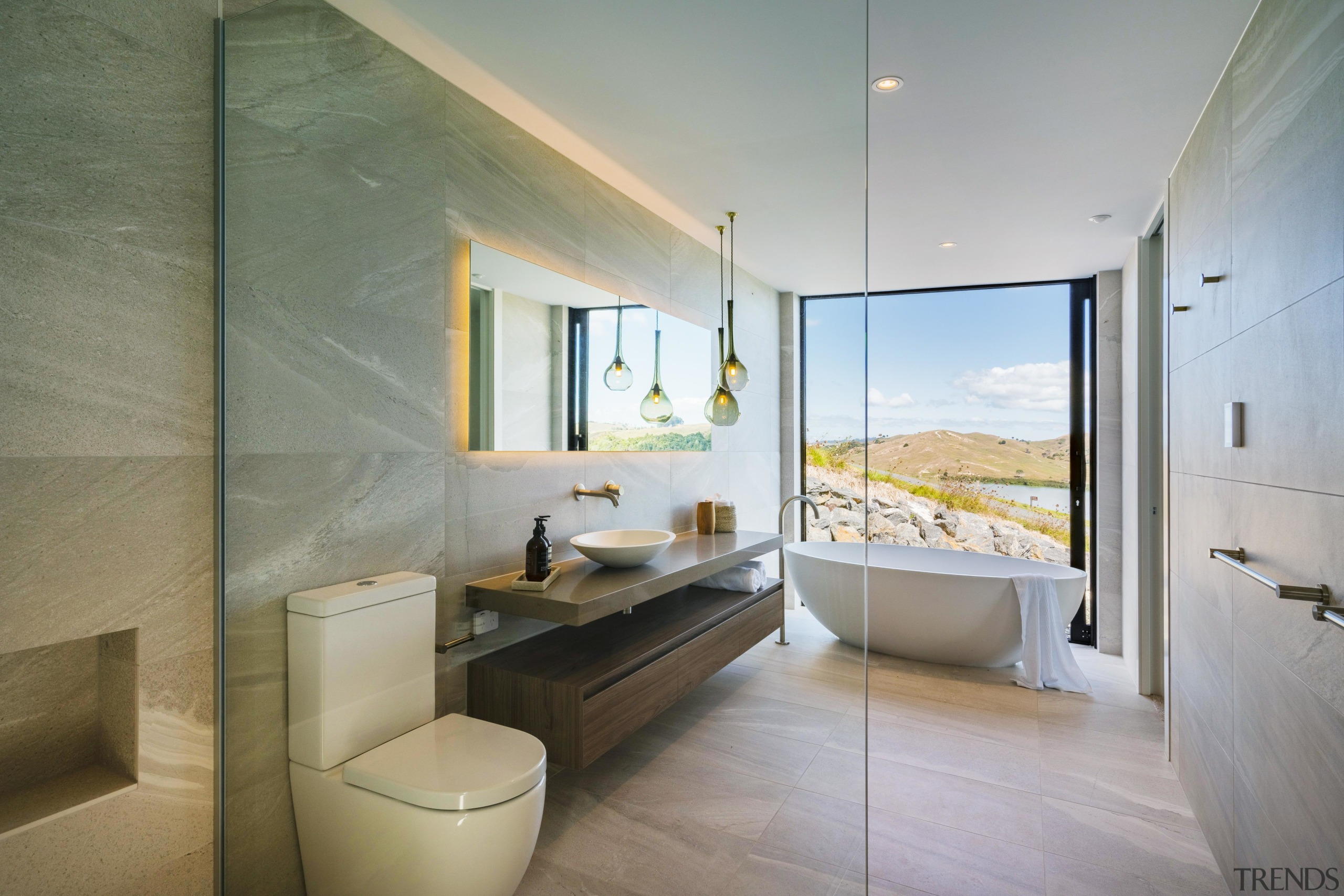 Taken from within the glass walled shower enclosure, gray