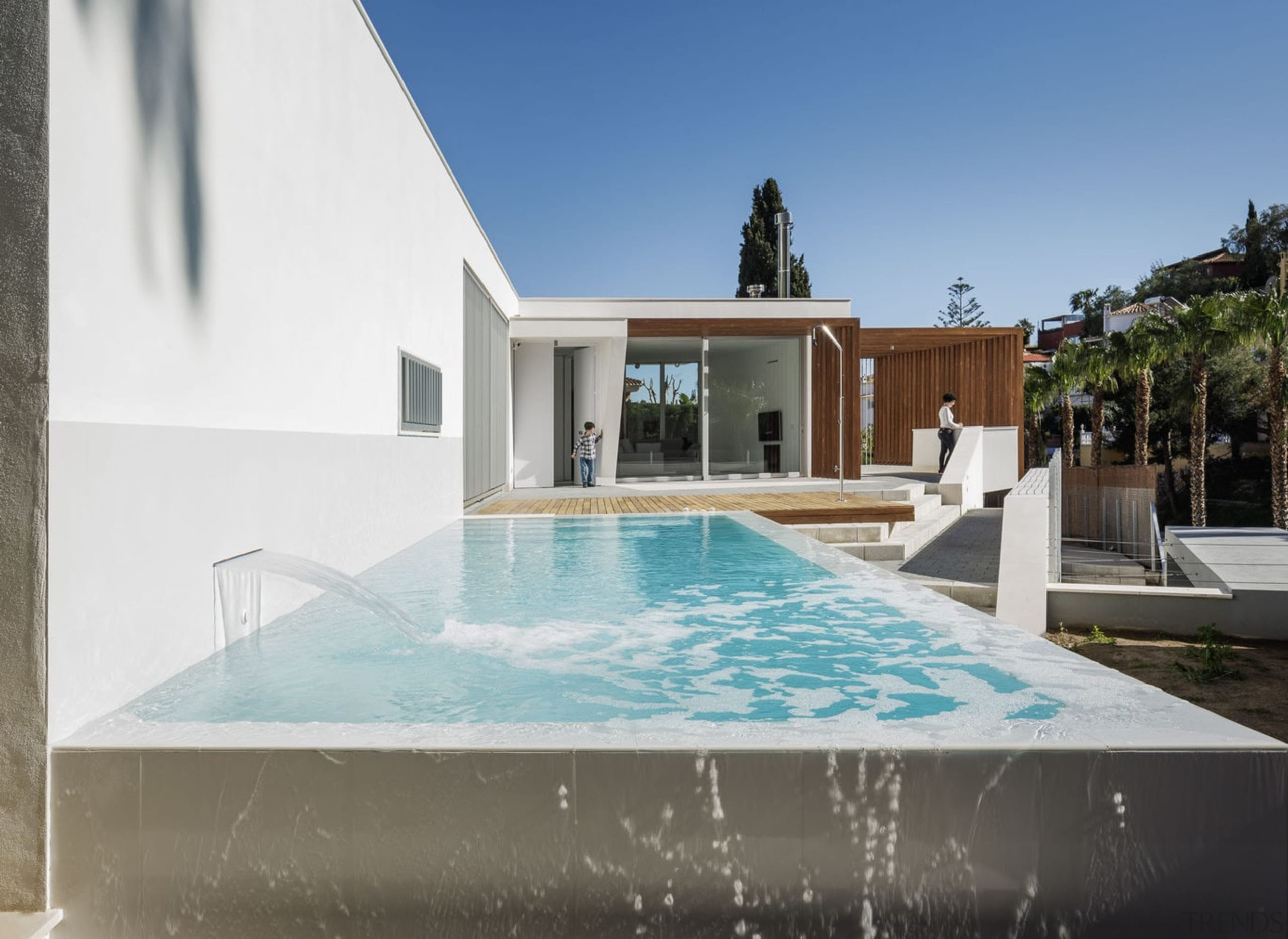 The pool provides a splash of colour - architecture, estate, home, house, property, real estate, swimming pool, villa, water, gray, white