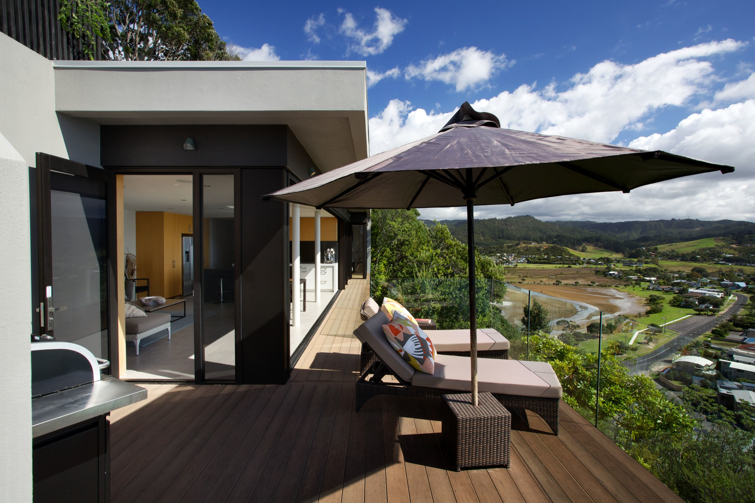 In this new holiday home a glass wall deck, estate, home, house, outdoor structure, property, real estate, resort, roof, shade, black