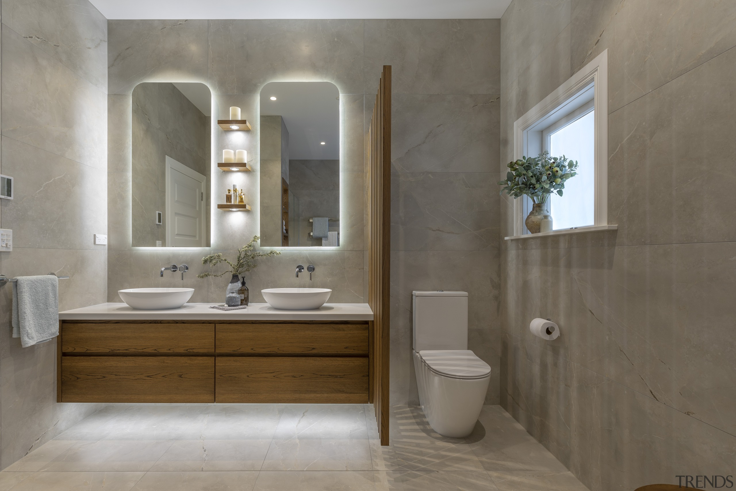 The wall cabinets and cantilevered vanity are both architecture, bathroom, bathroom accessory, bathroom cabinet, building, ceramic, floor, flooring, furniture, interior design, material property, plumbing fixture, property, room, sink, tap, tile, toilet, wall, gray