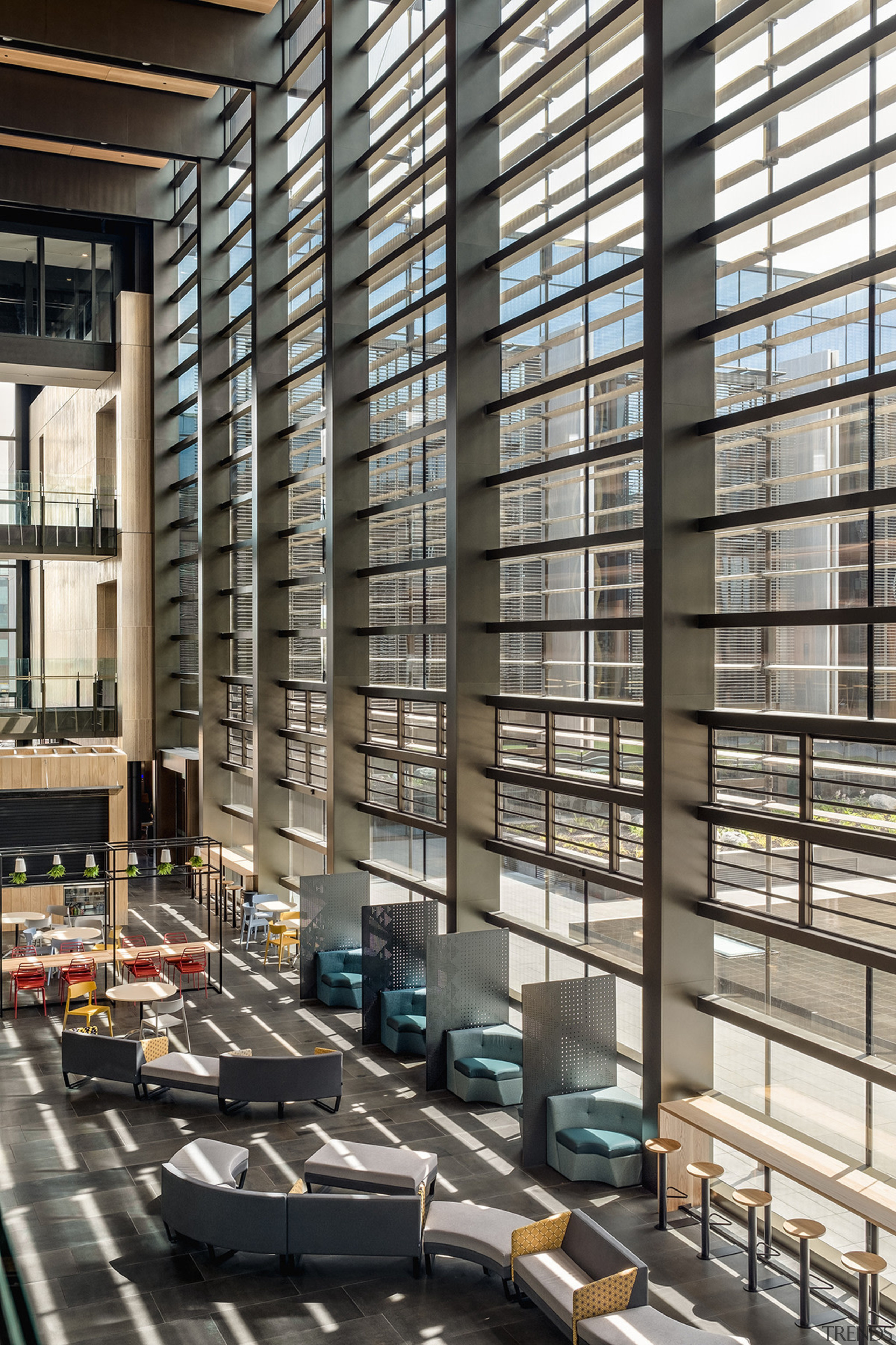 The glass-walled atrium in the Courts Building at architecture, building, condominium, facade, glass, window, black, gray